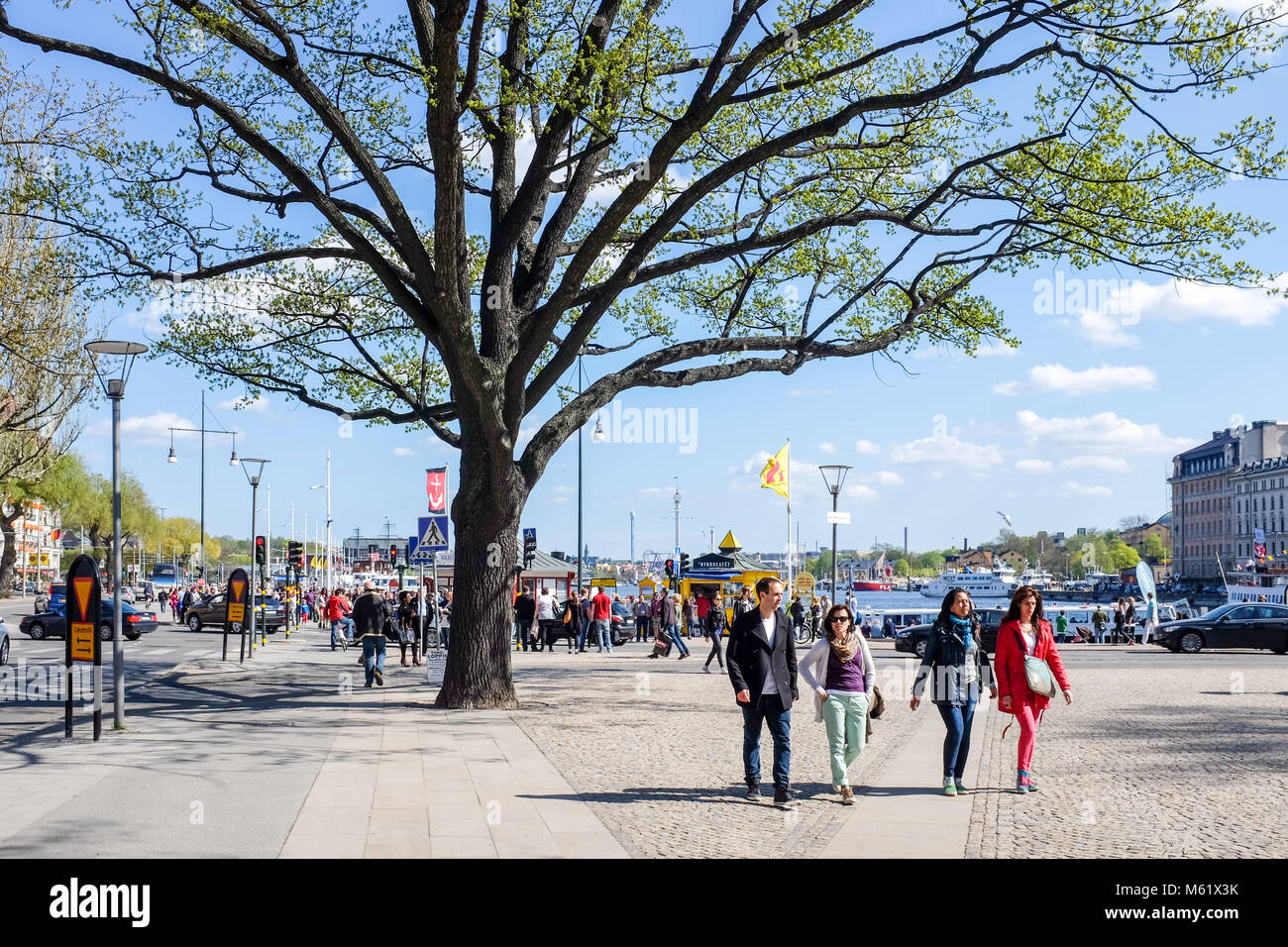 Tourists stroll at Nybroplan during springtime in Stockhom. Stockholm is a major travel destination. - Stock Image