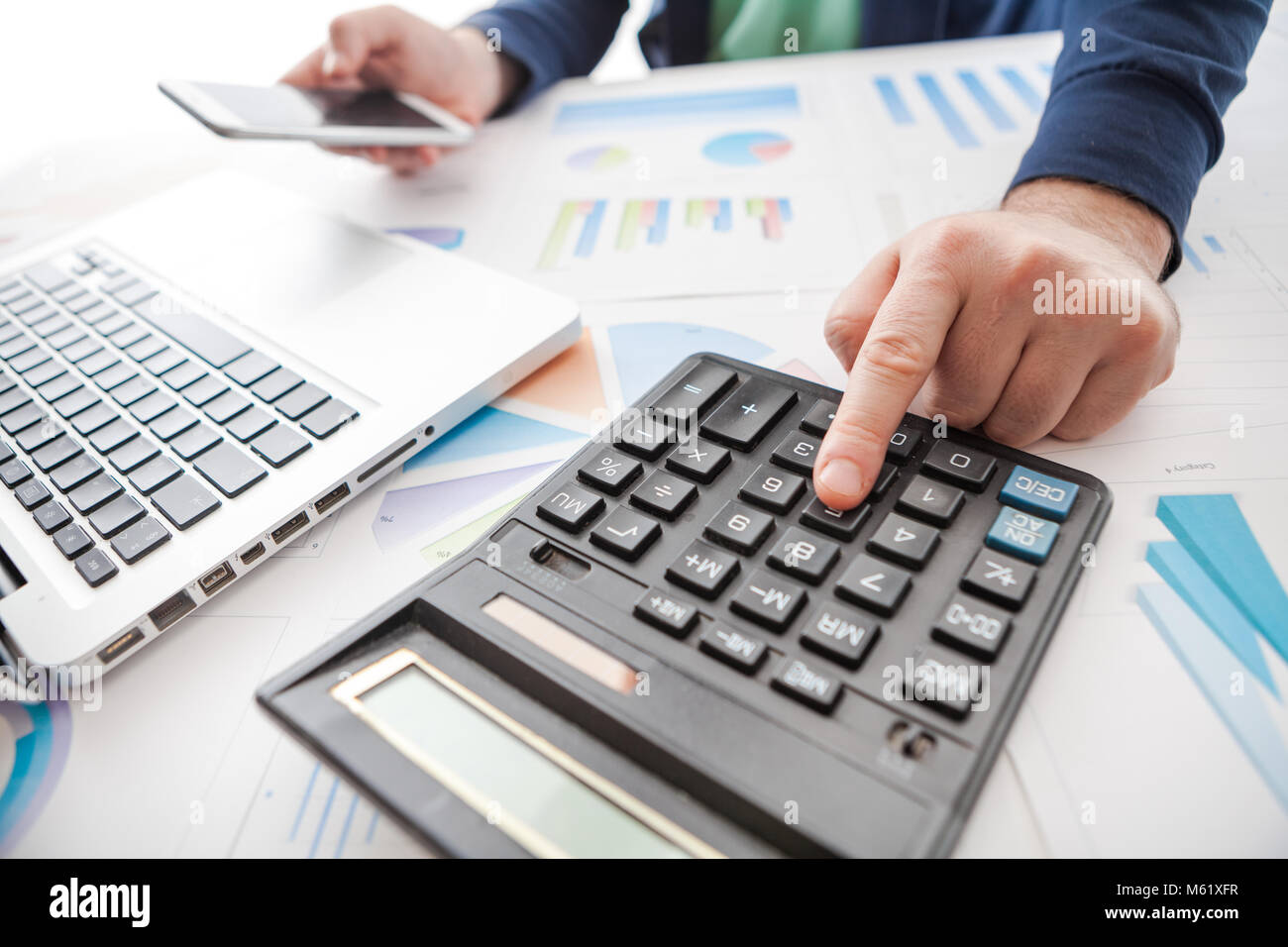 stock market chart and finger pointing on tablet in office Stock Photo