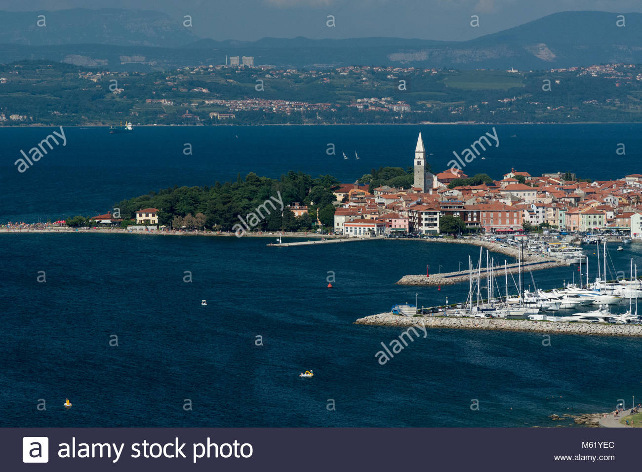 An elevated view of the town of Isola overlooking the Adriatic Sea. - Stock Image