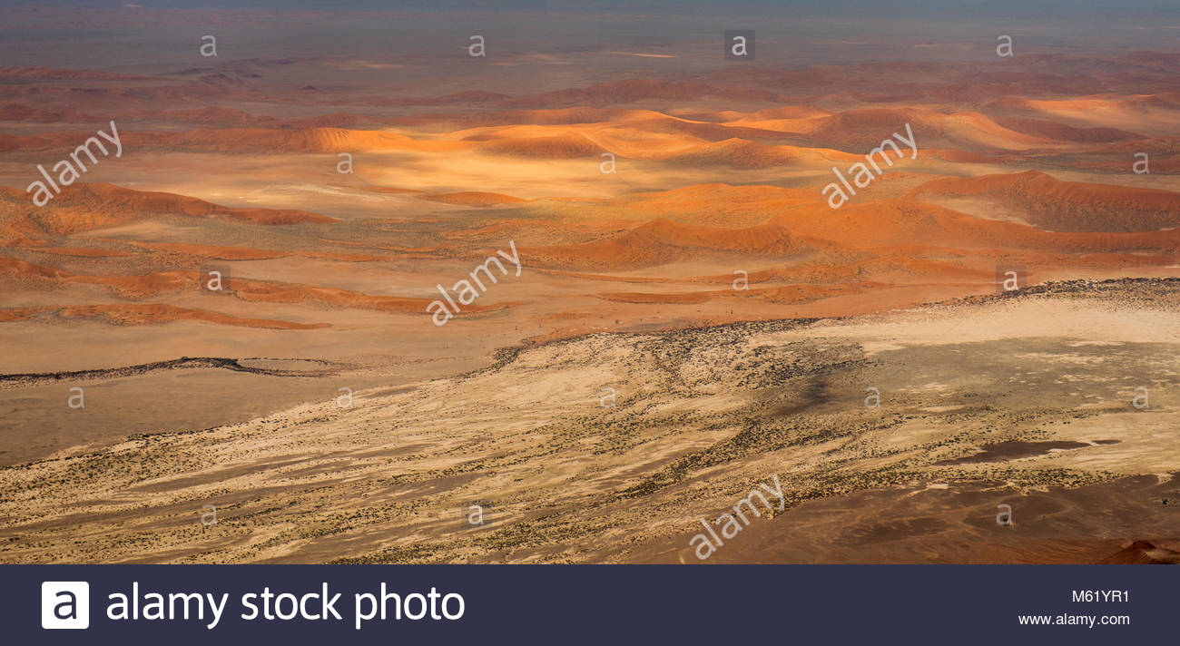 An aerial of the red sand dunes of the Namib Desert. Stock Photo