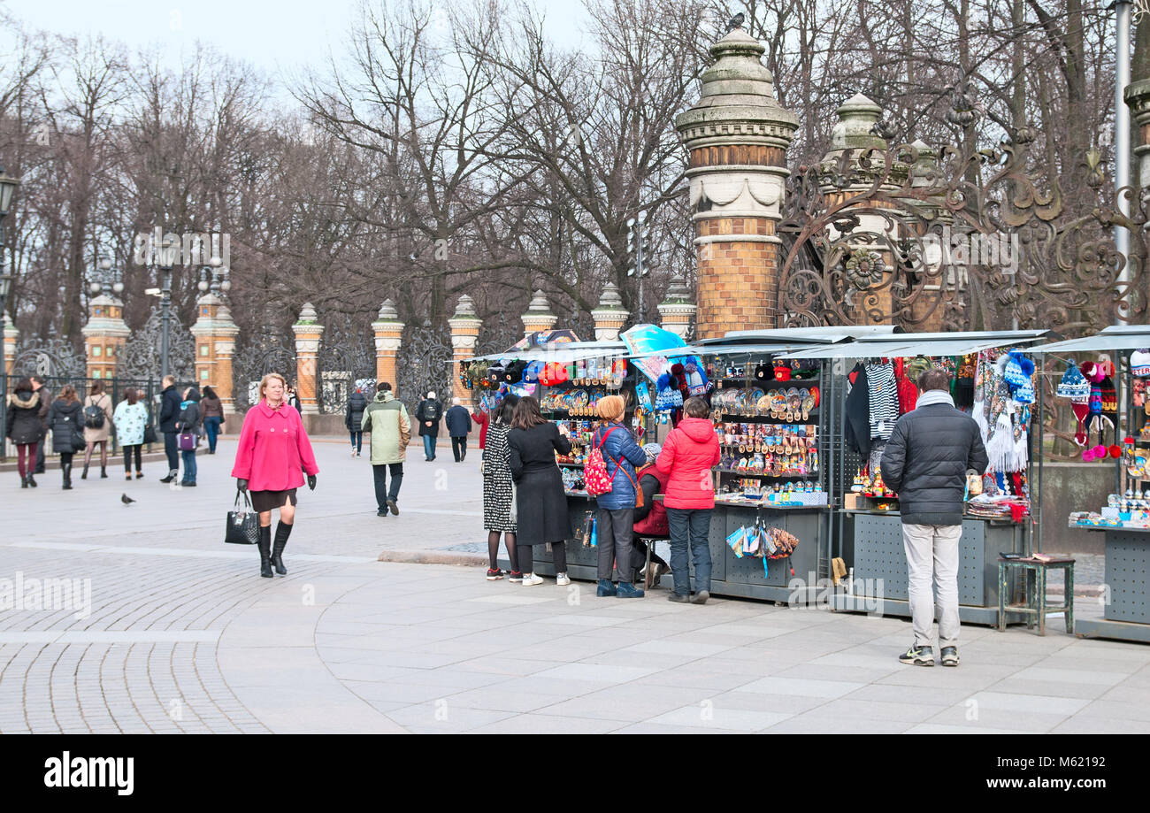 SAINT - PETERSBURG, RUSSIA - APRIL 8, 2016: People near open air souvenir shops next to The Church of the Resurrection Stock Photo