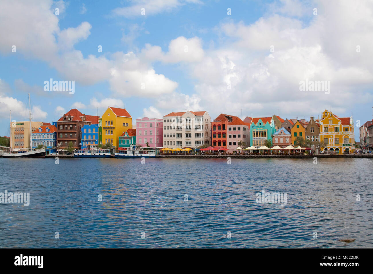 Trade arcade historical colonial buildings and gastronomy at waterfront, Punda district, Willemstad, Curacao, Netherlands - Stock Image