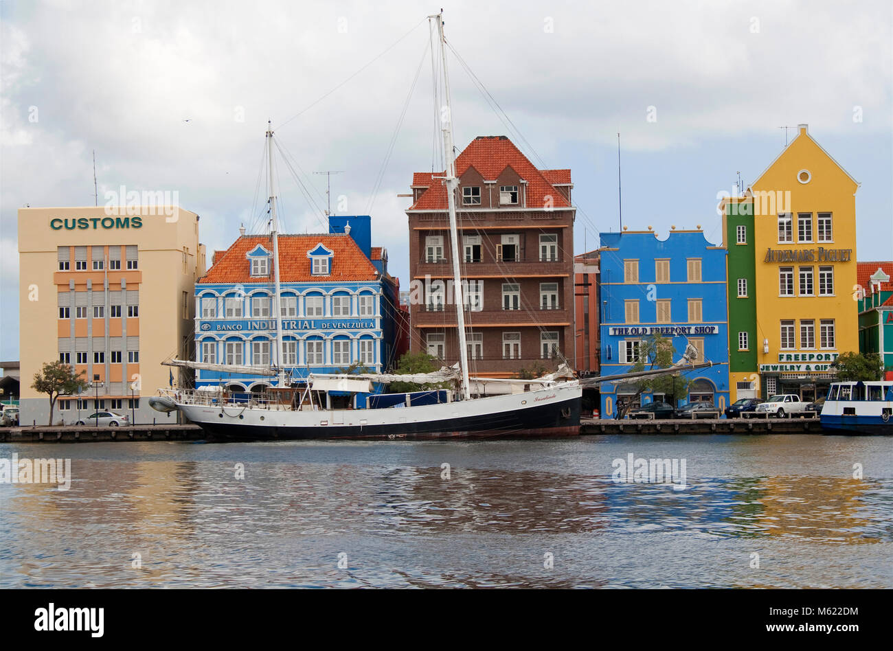 Sailing ship (brigantine) at trade arcade, historical colonial buildings, Punda district, Willemstad, Curacao, Netherlands - Stock Image