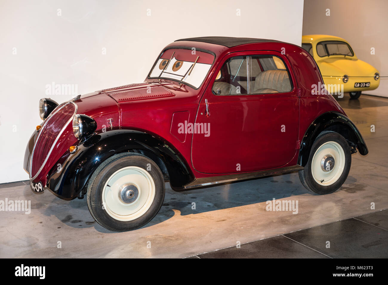 Malaga, Spain - December 7, 2016: Vintage Fiat 500 Topolino (model 1936) Italy car displayed at Malaga Automobile - Stock Image