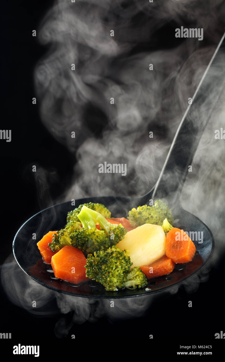 Steamed Broccoli Potatoes And Carrots With Steam Stock Photo Alamy