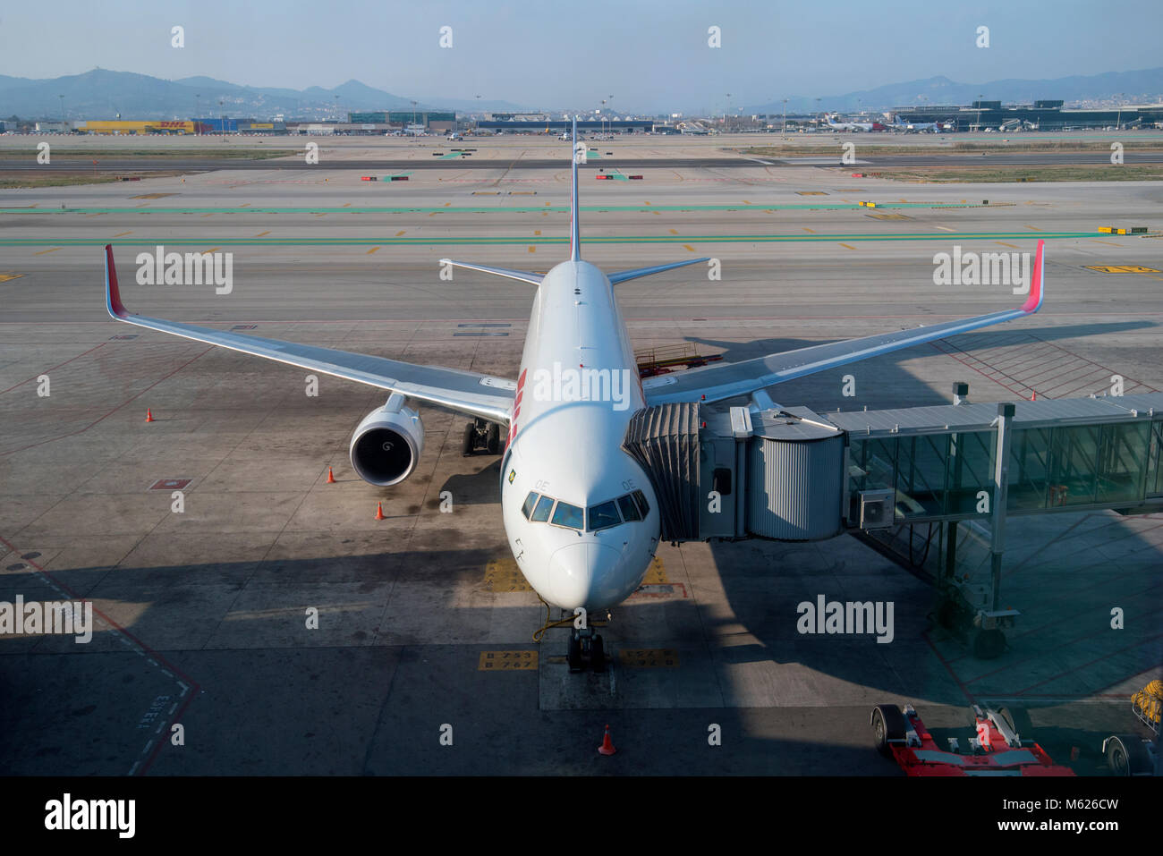Looking out to airside at Barcelona airport - Stock Image