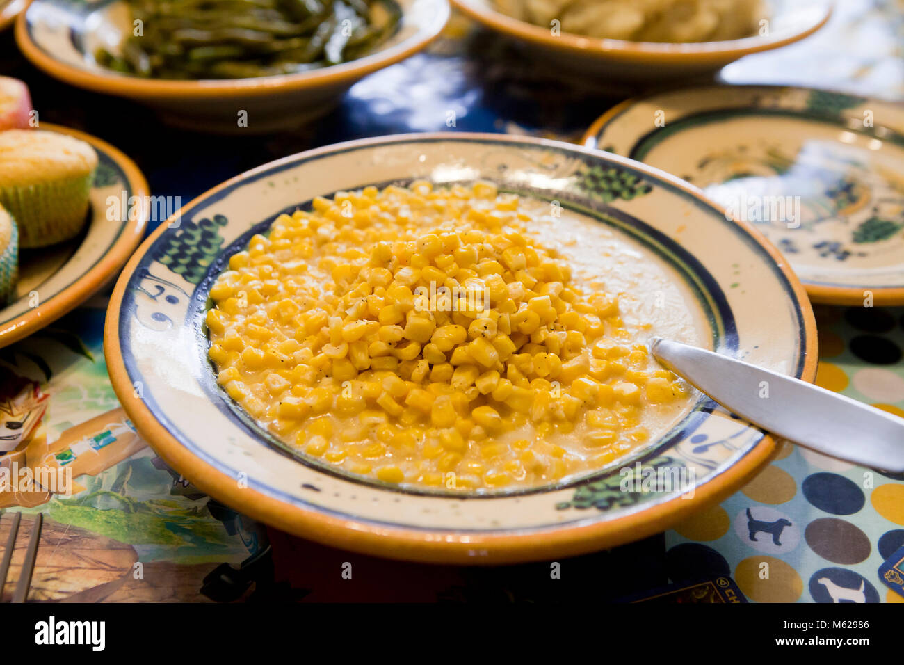 Creamed corn side dish on dinner table - USA - Stock Image
