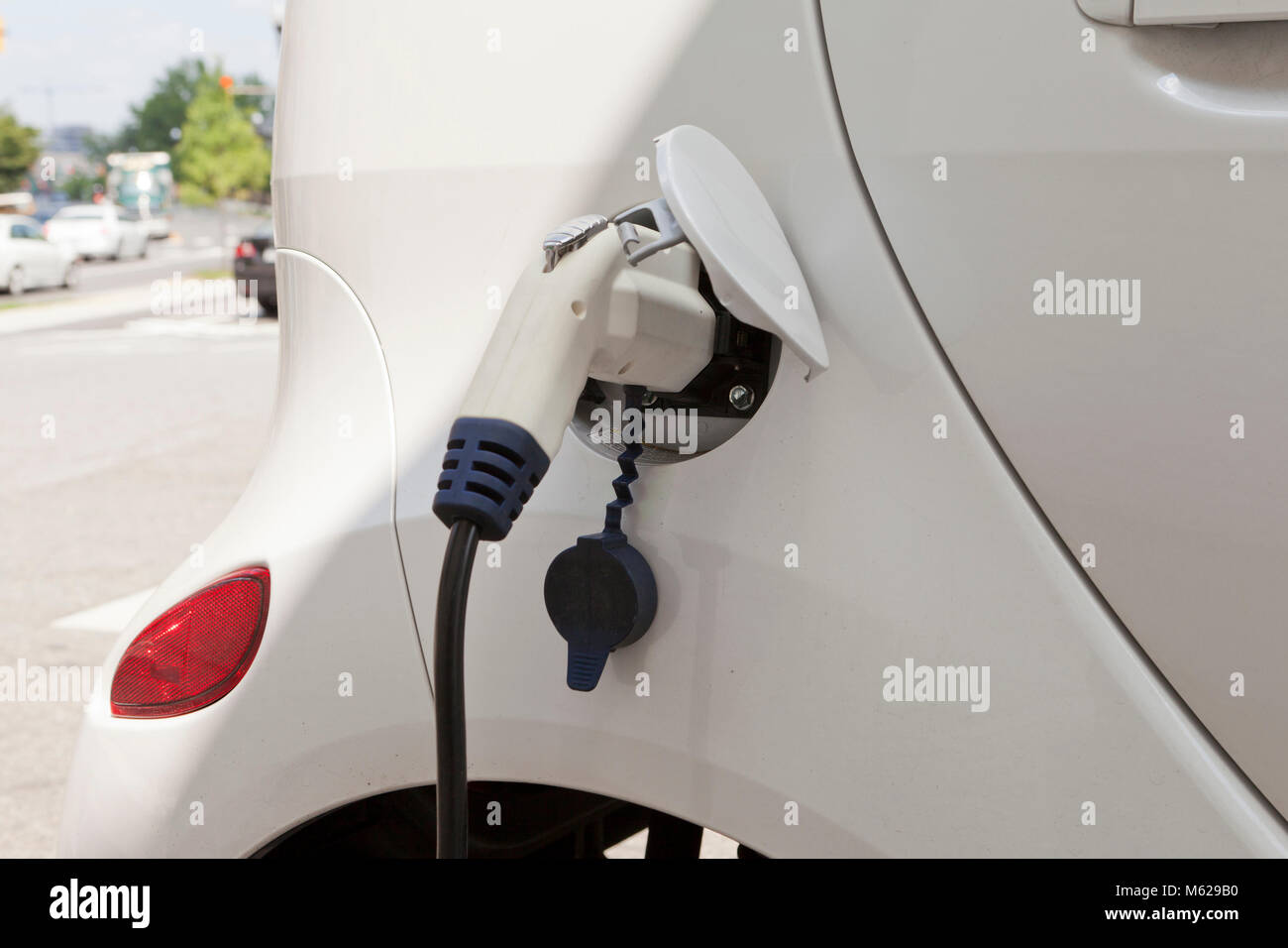 Power plug in electric car - USA - Stock Image