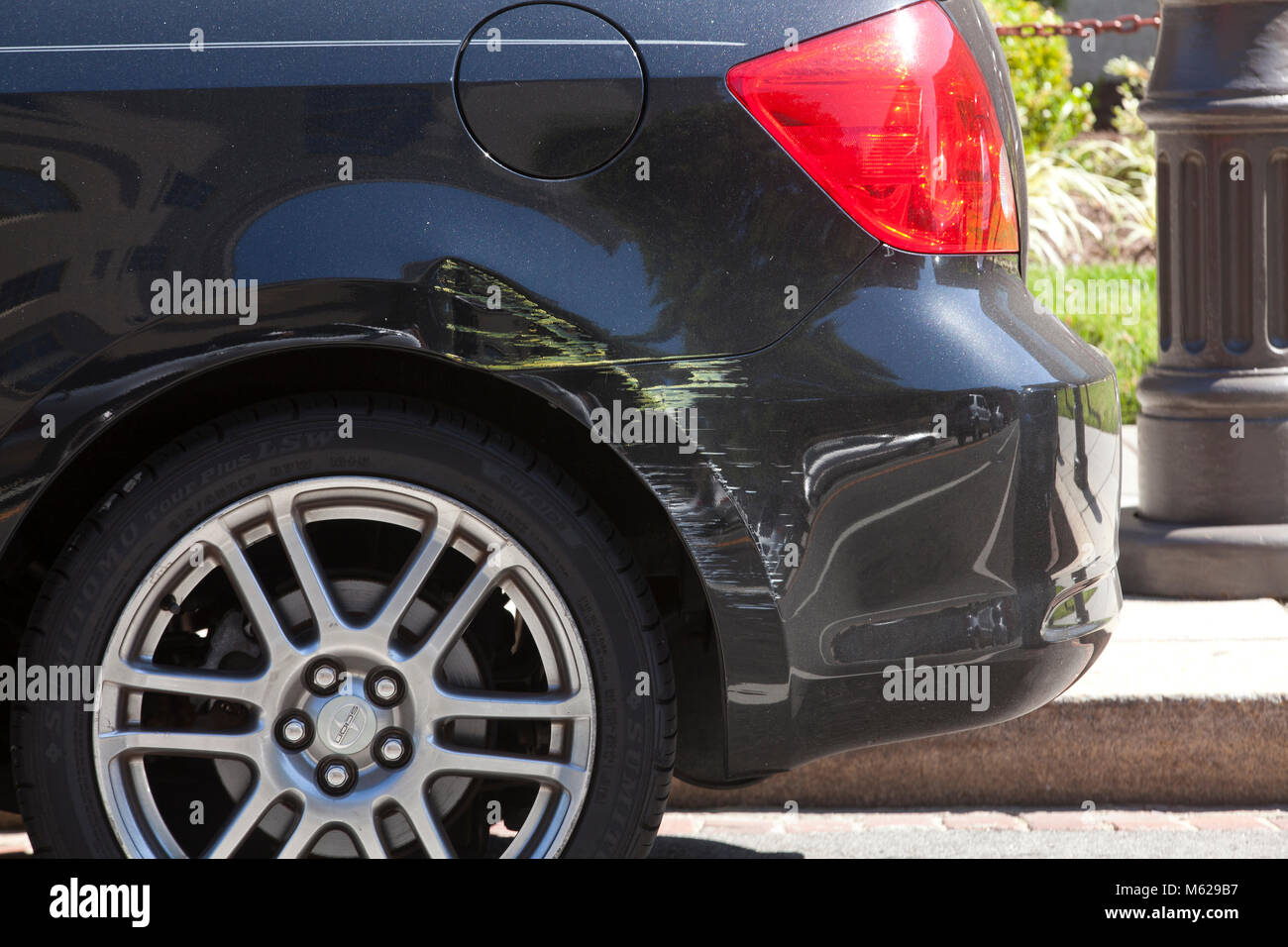Rear fender damage on compact car (body damage, scratched car paint) - USA - Stock Image