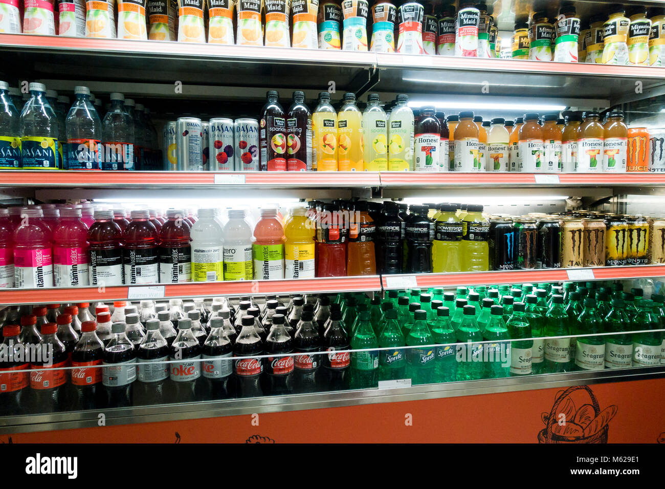 Cold carbonated drinks in open display refrigerator at a convenience store - USA - Stock Image
