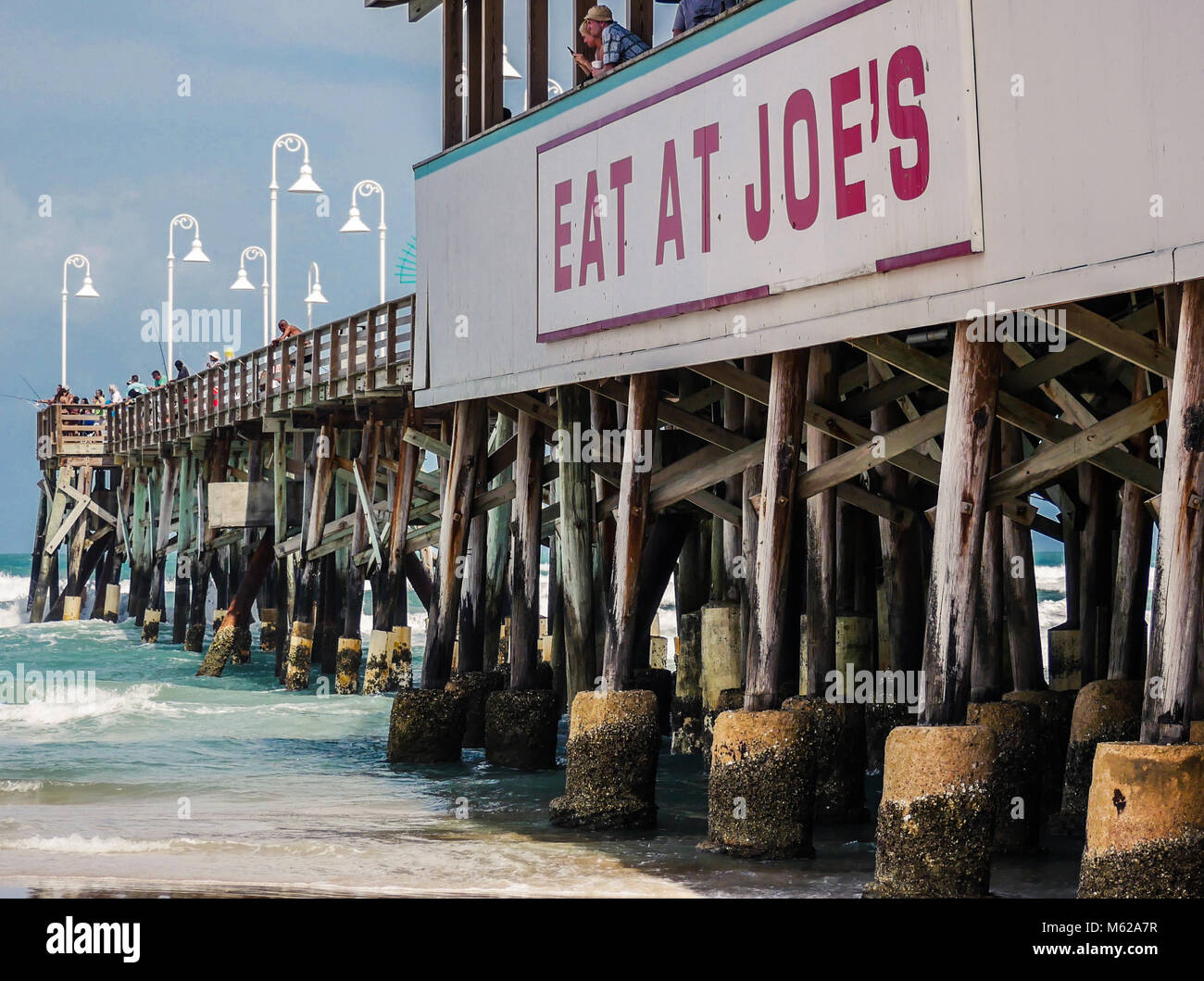 DAYTONA BEACH, FLORIDA - APRIL 15, 2017: Anglers fishing on the Daytona Beach Pier during Easter holiday weekend. - Stock Image