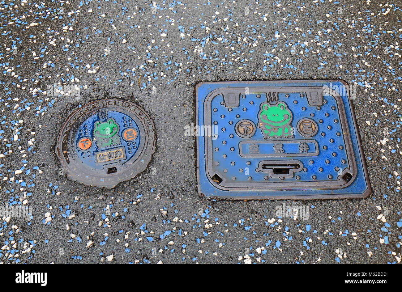 Cute design utility hole cover in Gero city Japan - Stock Image