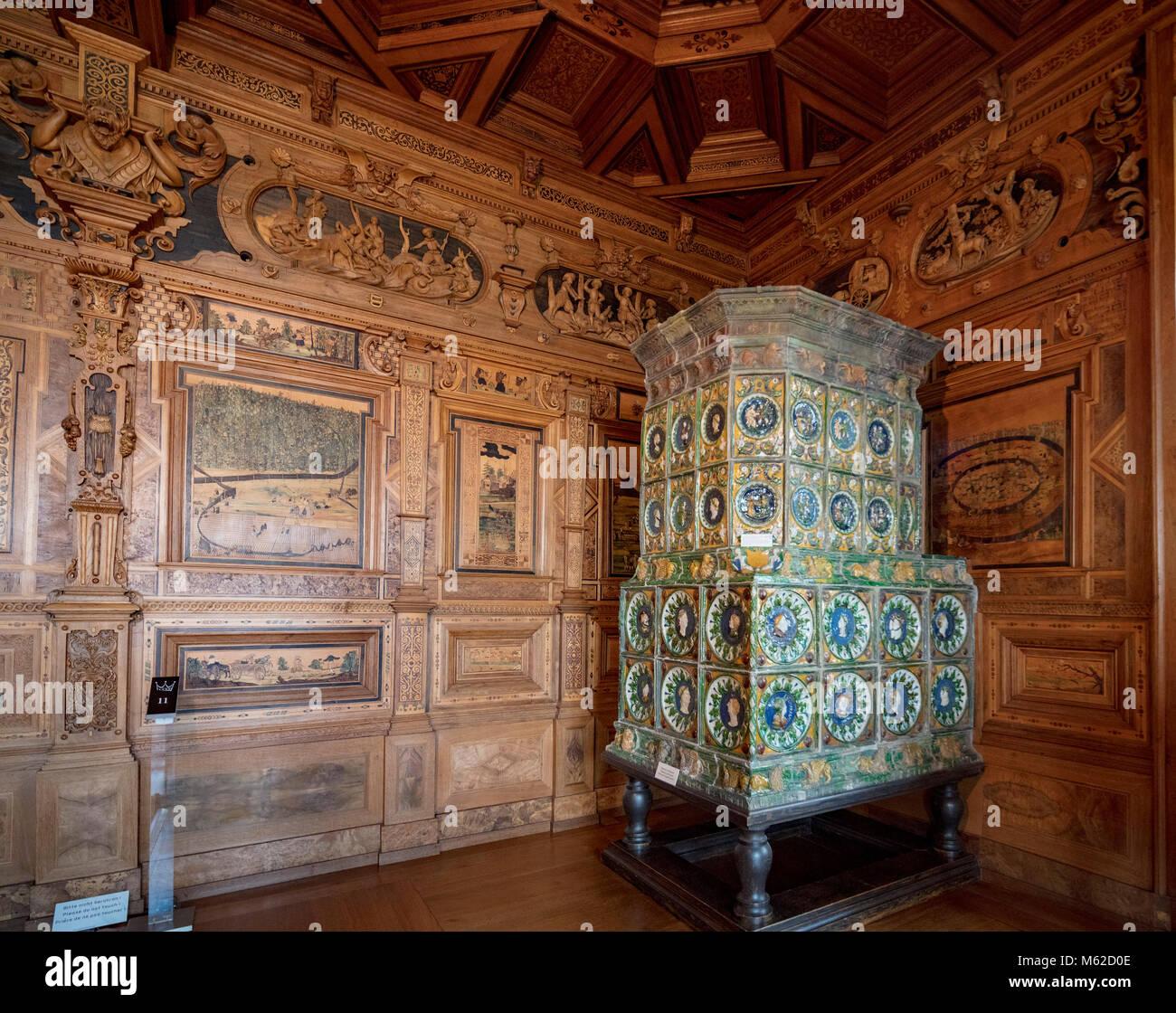 INTARSIA HUNTING ROOM with tiled stove made in 1540 in Nuremberg, Veste Coburg, Franconia, Bavaria, Germany - Stock Image