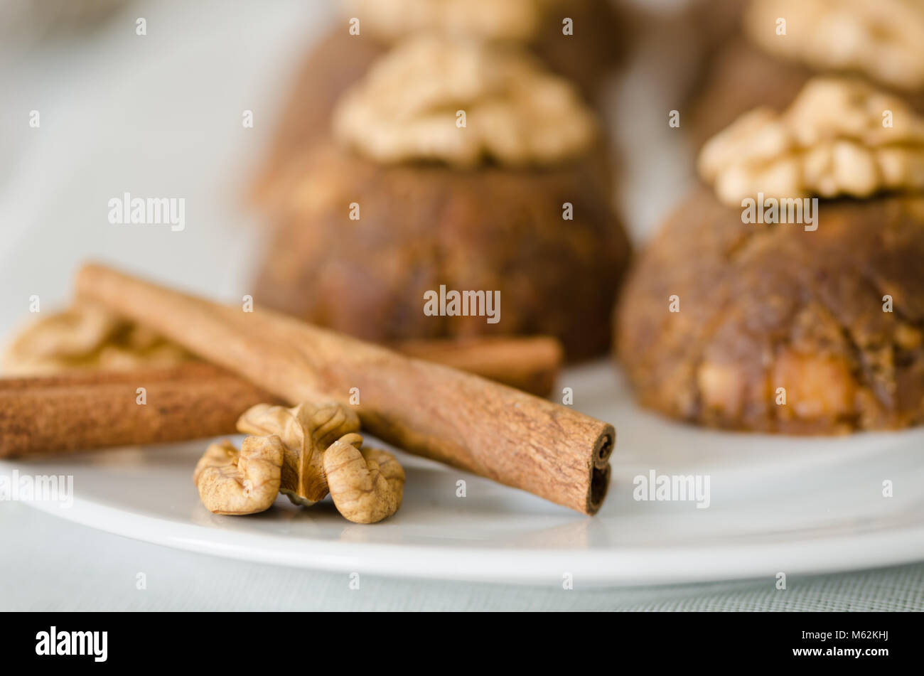 Traditional Turkish sweet dessert halva with walnut on the white plate. - Stock Image