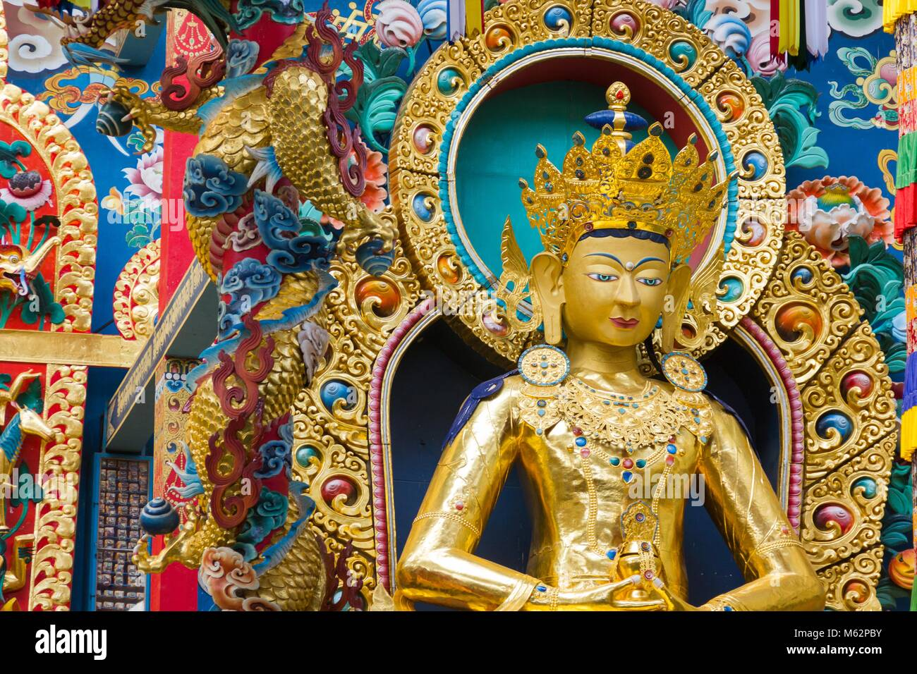 Buddha Amitayus golden statue at Namdroling Monastery in Bylakuppe, Karnataka, India. Tibetan Buddhist religion Stock Photo