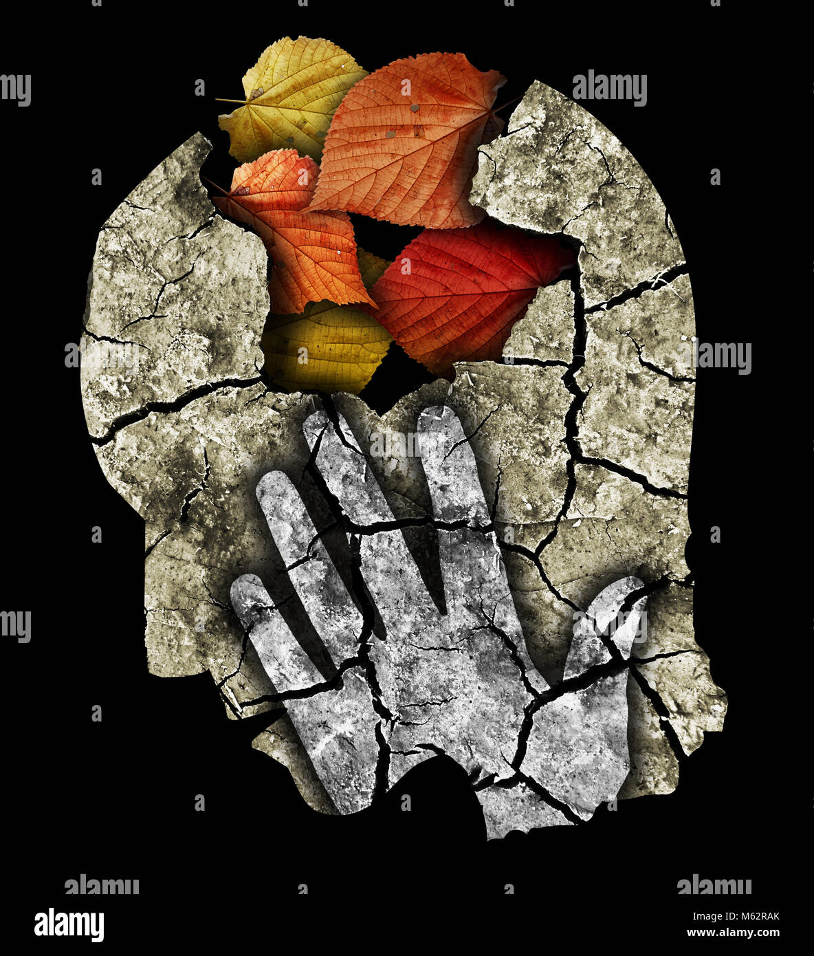 Dementia depression Alzheimers disease. Stylized male head silhouette holding his head.Photo-montage with Dry cracked - Stock Image