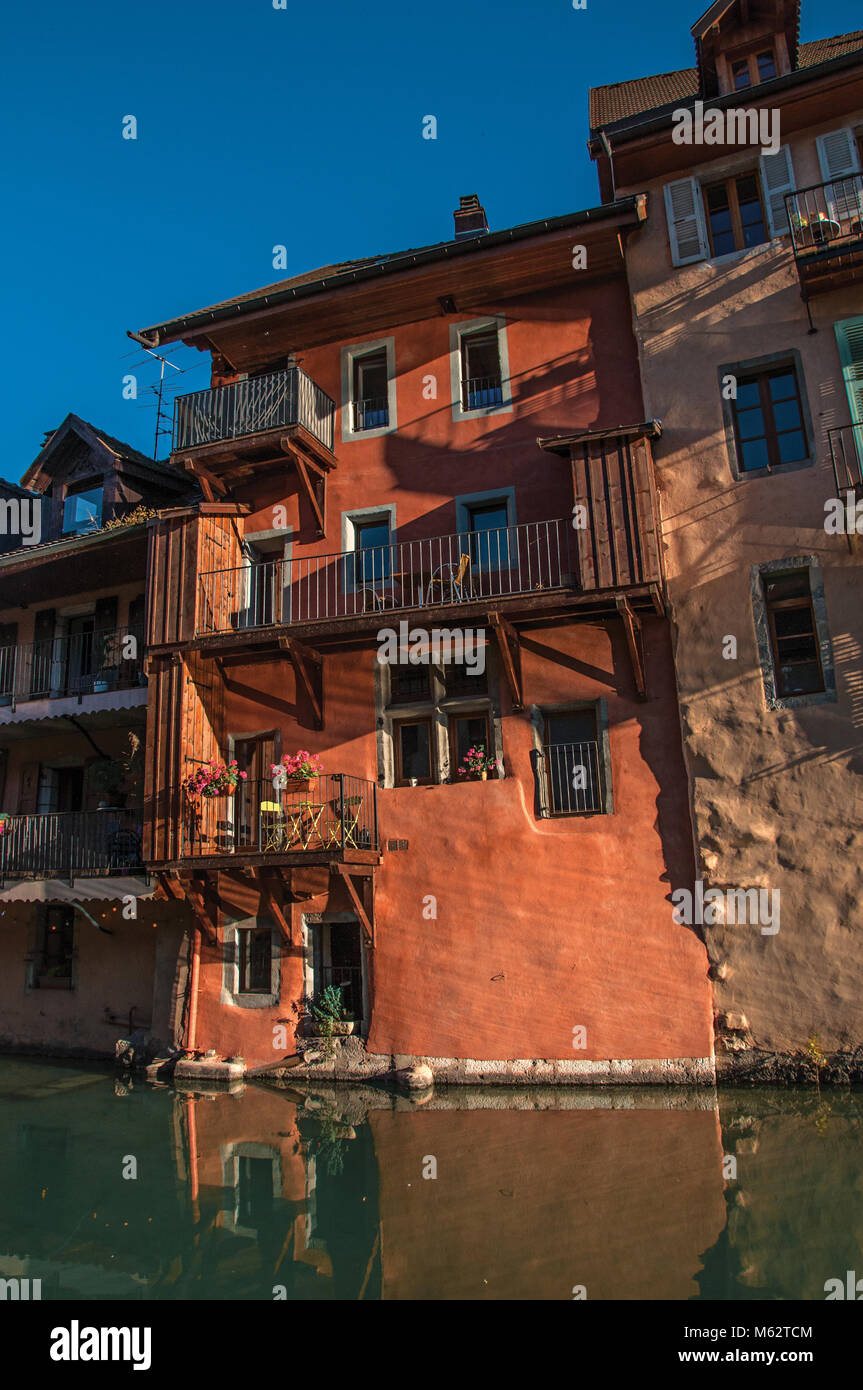 Old buildings at the city center of Annecy, in front of the canal, with blue sky and sundown's light. Department - Stock Image