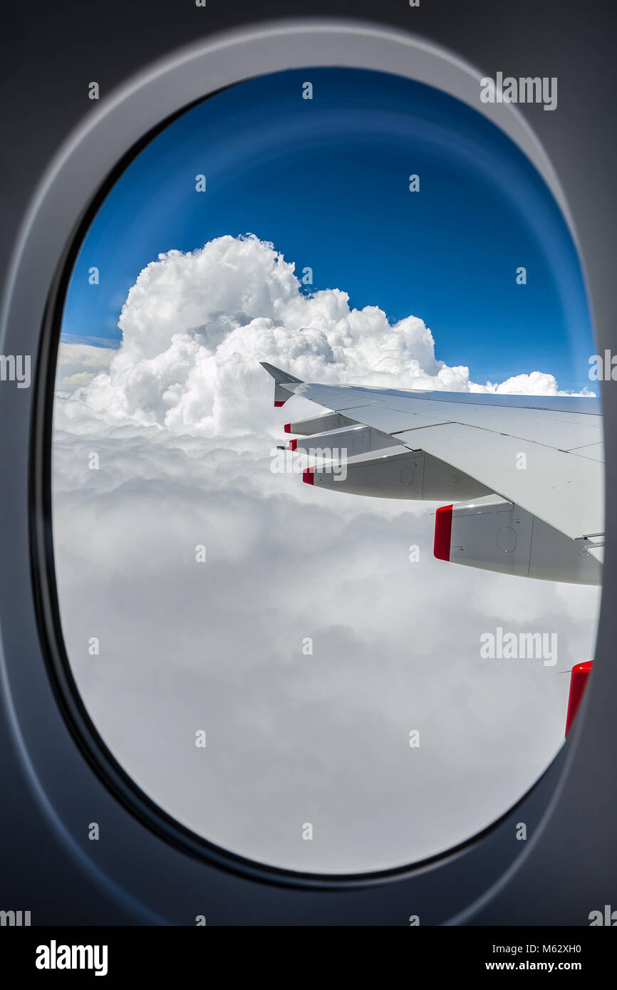 View of an airplane wing out the window Stock Photo