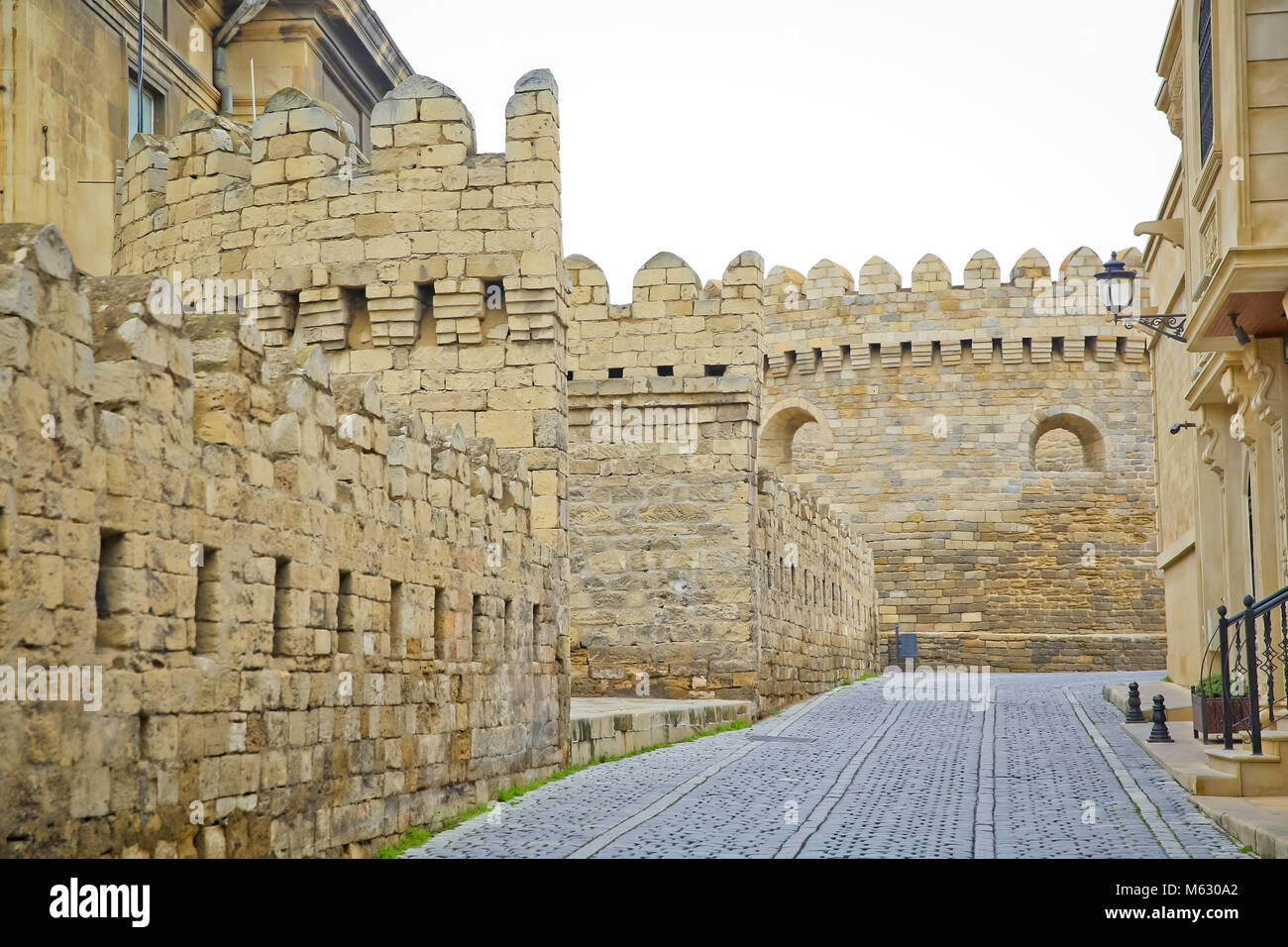 The fortress gates of the old city in the illumination . Icheri Sheher in Baku. Azerbaijan . Gate of the old fortress, - Stock Image