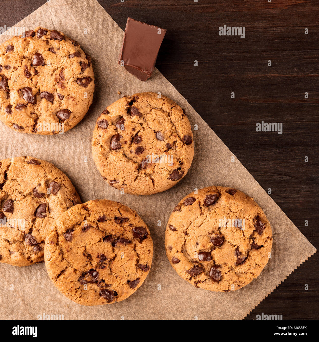 Chocolate chips cookies on baking paper with copyspace, square photo Stock Photo
