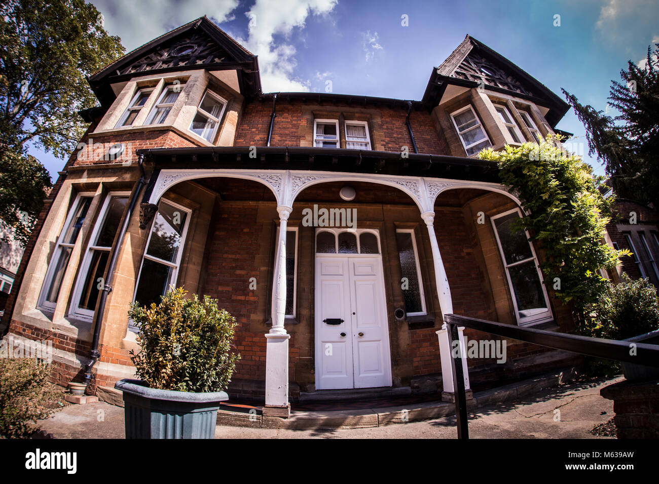 Large Victorian red brick detached house in Oxford, UK - Stock Image