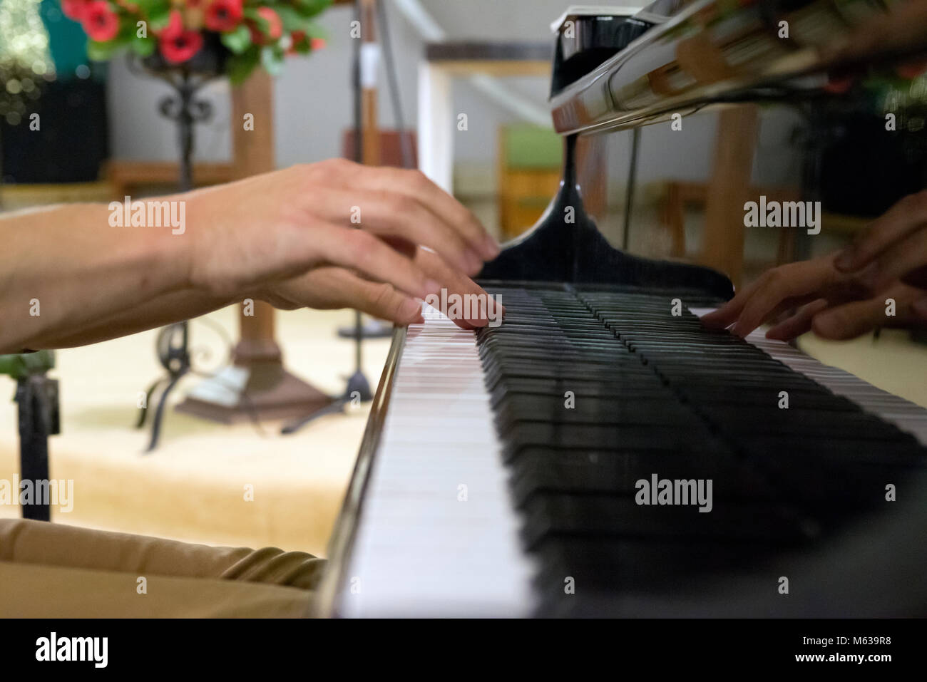 Male hands playing piano - Stock Image