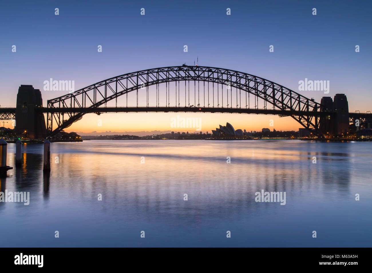 Sydney Harbour Bridge and Sydney Opera House at dawn, Sydney, New South Wales, Australia - Stock Image