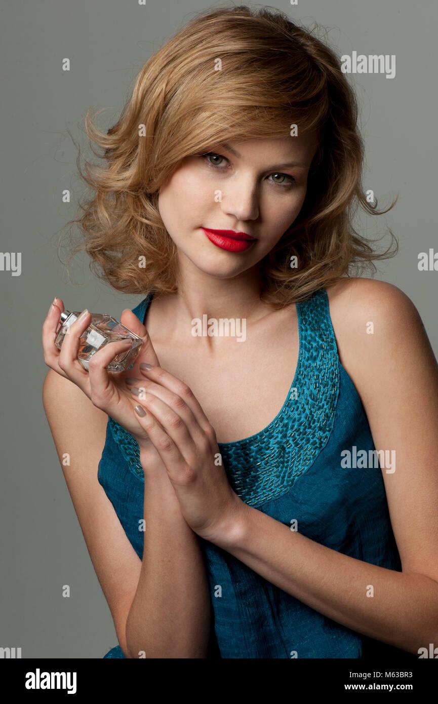 Woman with perfume bottle - Stock Image