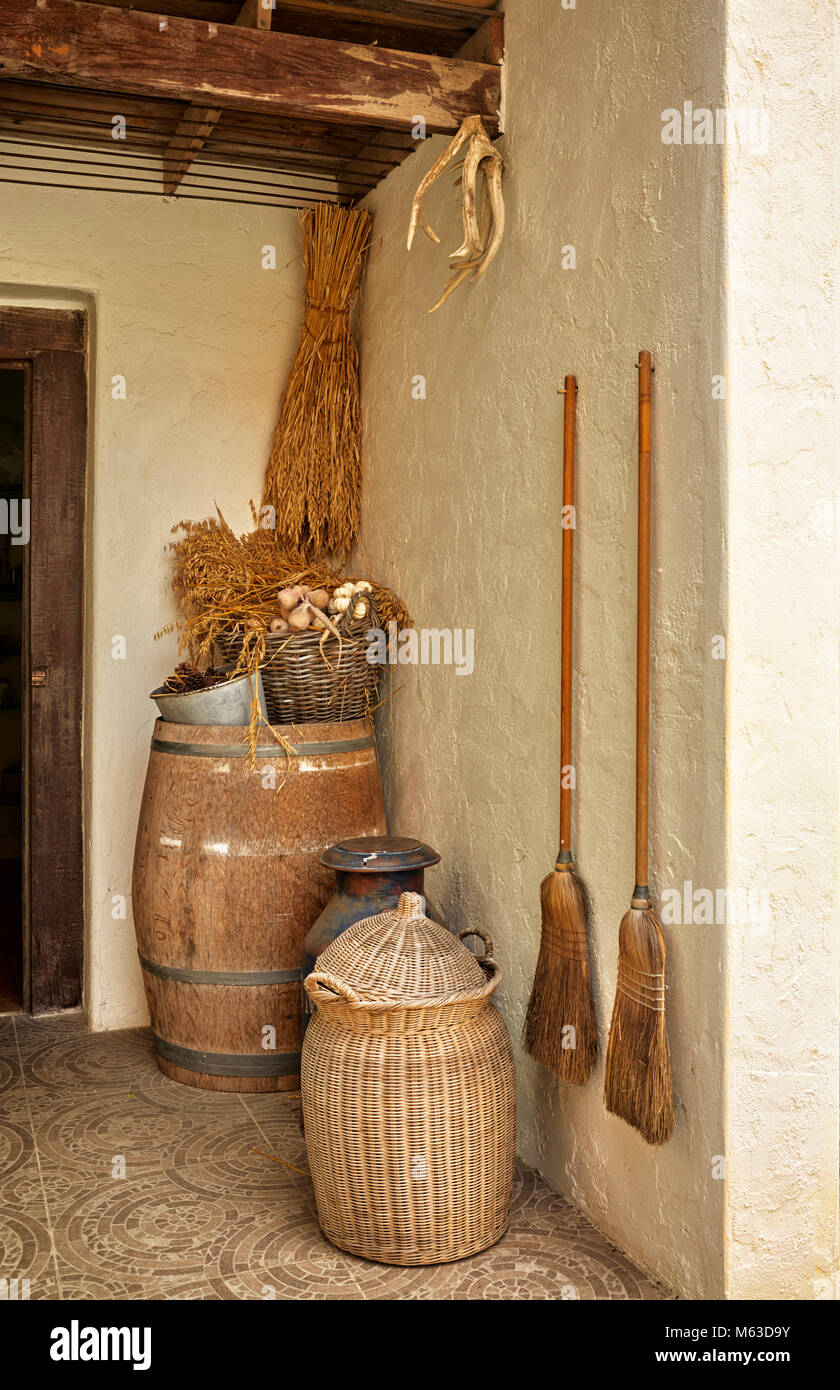 Traditional rural cottage home entrance porch with vintage objects - Stock Image