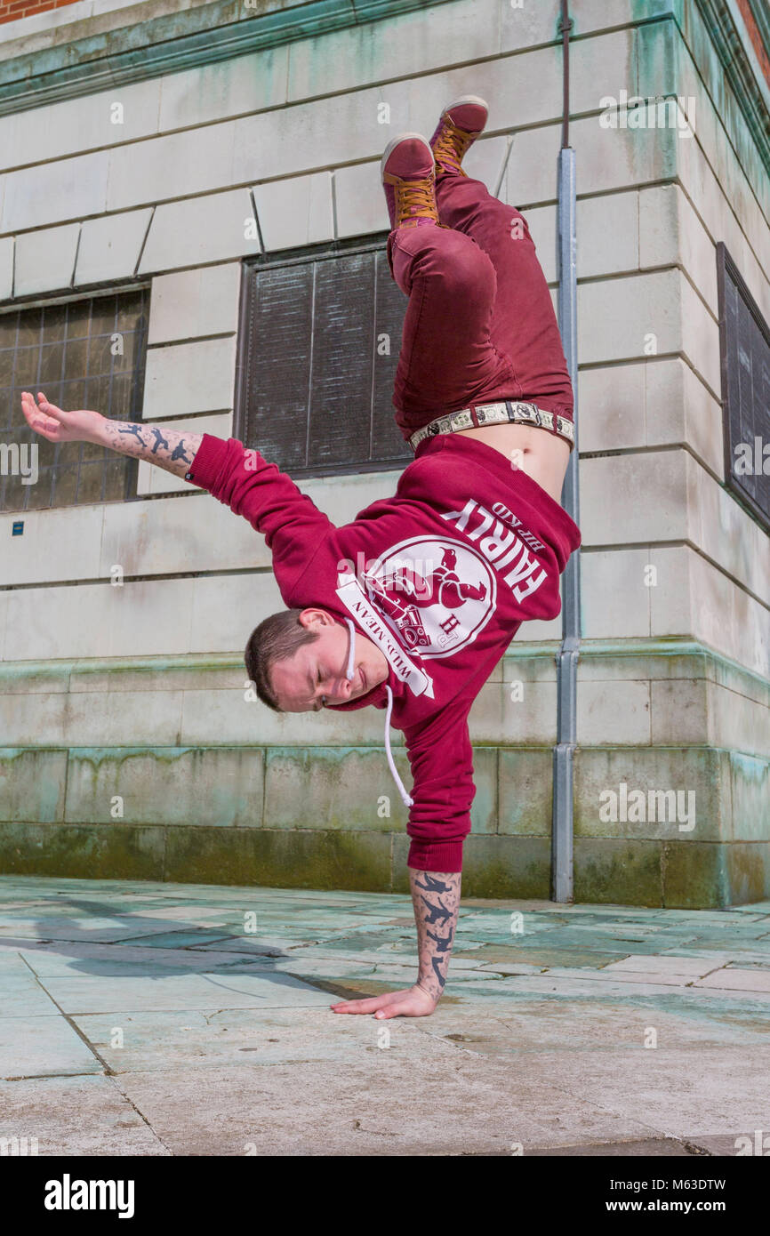 Breakdancer practicing in a public park. Stock Photo
