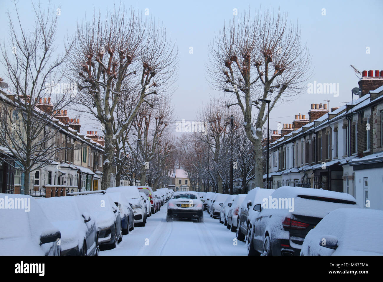 LONDON, UK - February 28: Streets of East London were covered with snow following a shower on 28 February. The Met - Stock Image