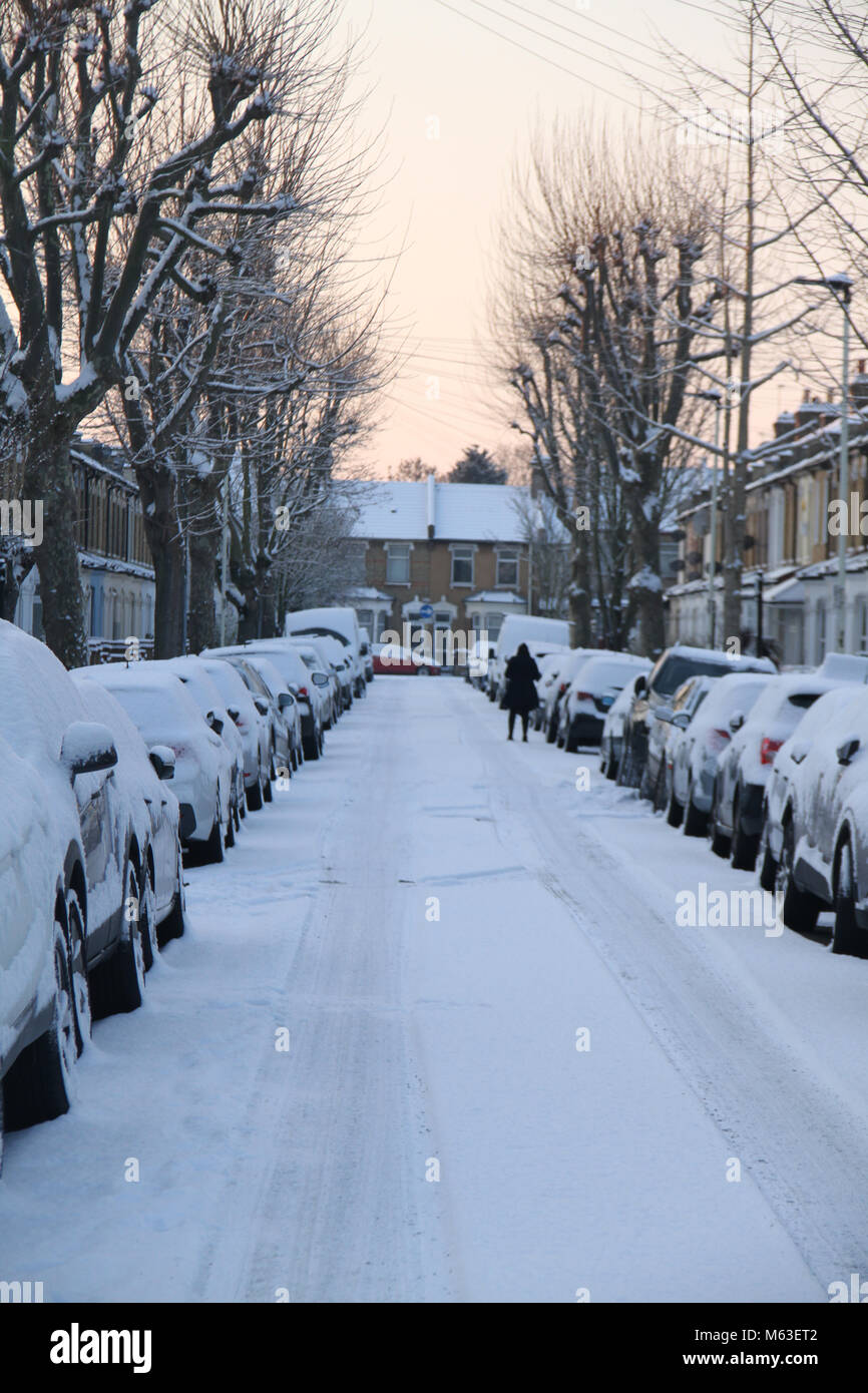 London, UK. 28th Feb, 2018. UK Weather: Streets of East London were covered with snow follwoing  a shower on 28 - Stock Image