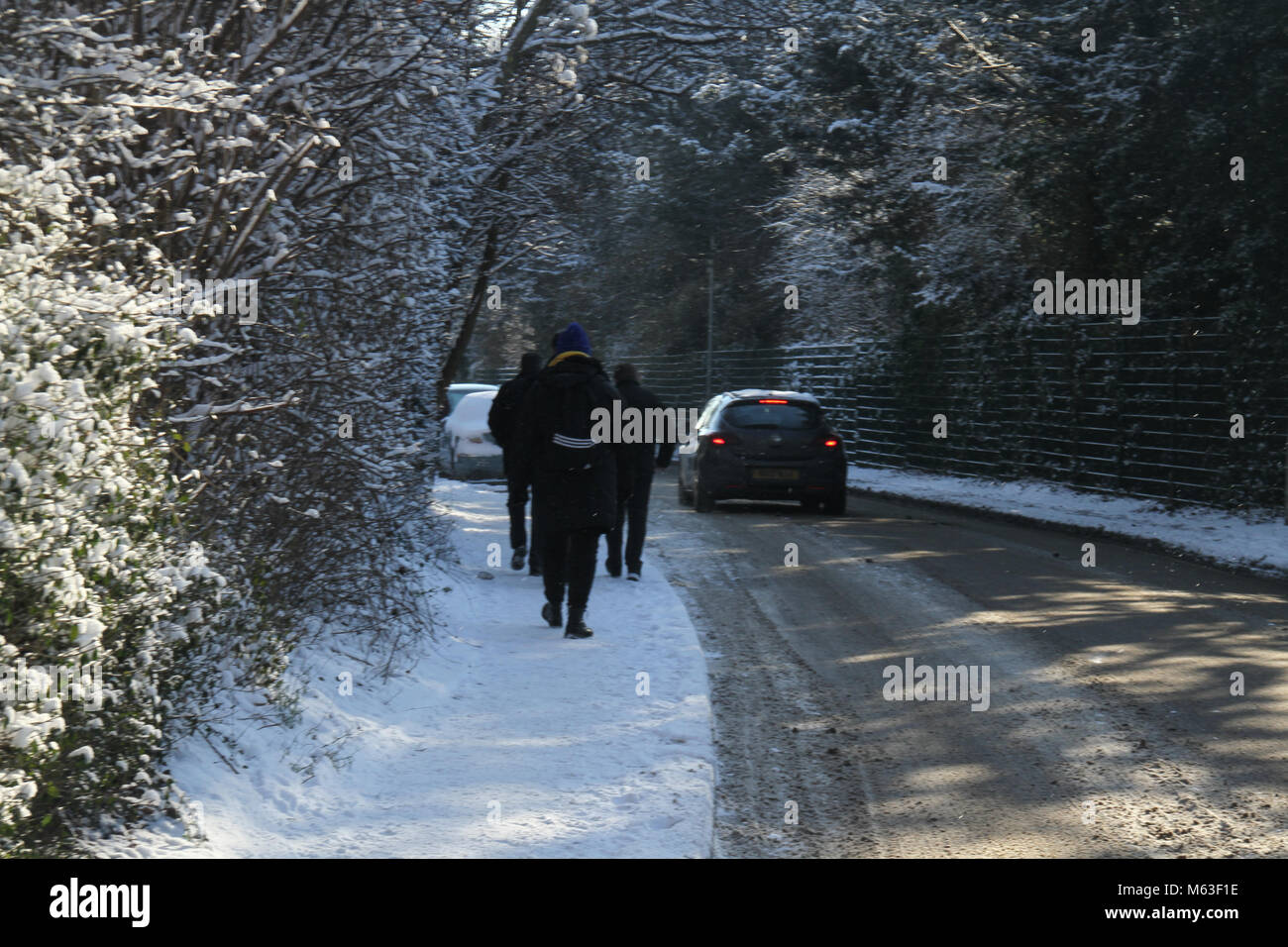 Purfleet, UK - February 28: Pedestrians walk on London Road on 28 February morning following a snowstorm that covered - Stock Image