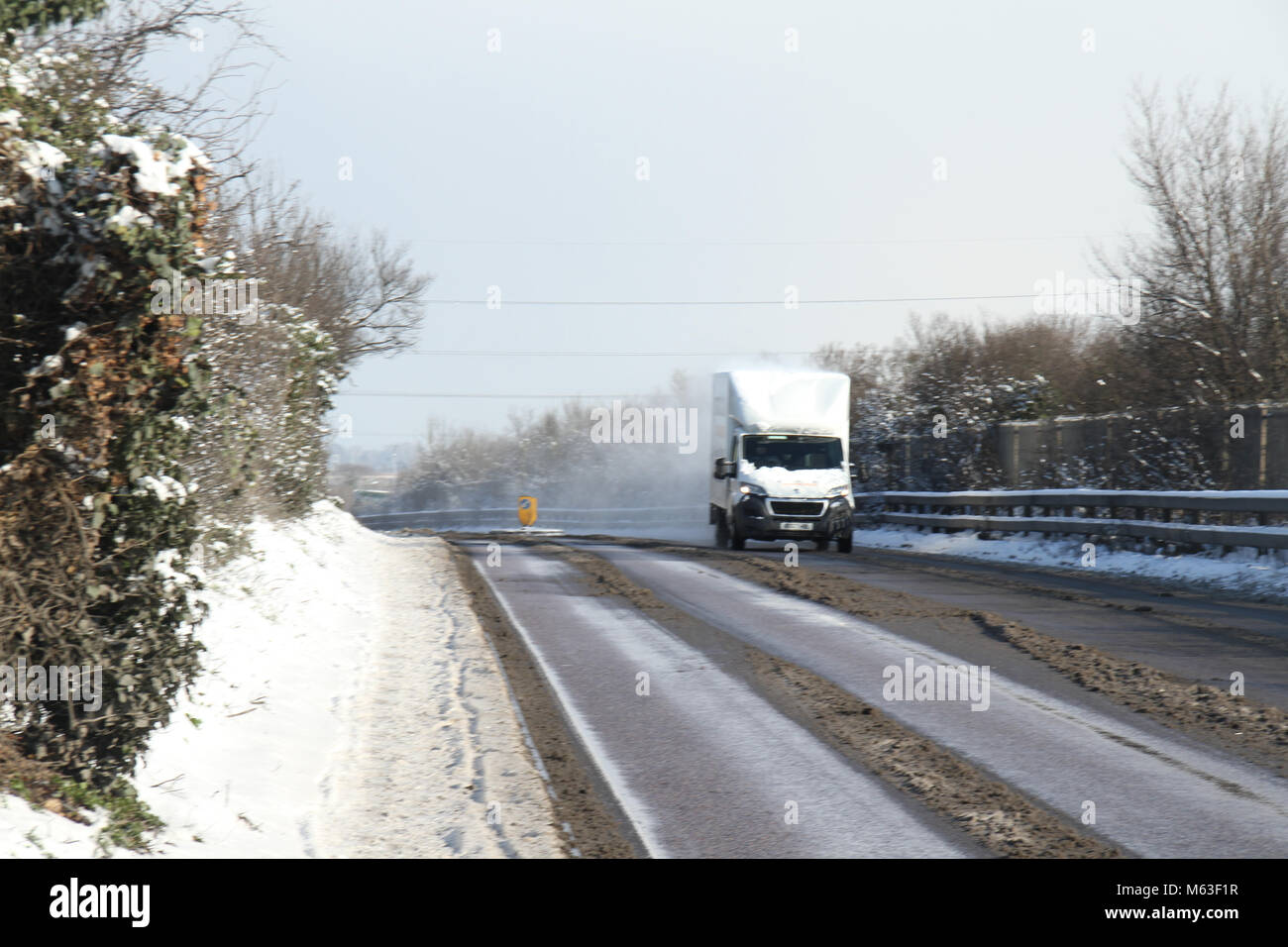 Purfleet, UK - February 28: Motorist and pedestrians commute on 28 February morning following a snowstorm that covered - Stock Image