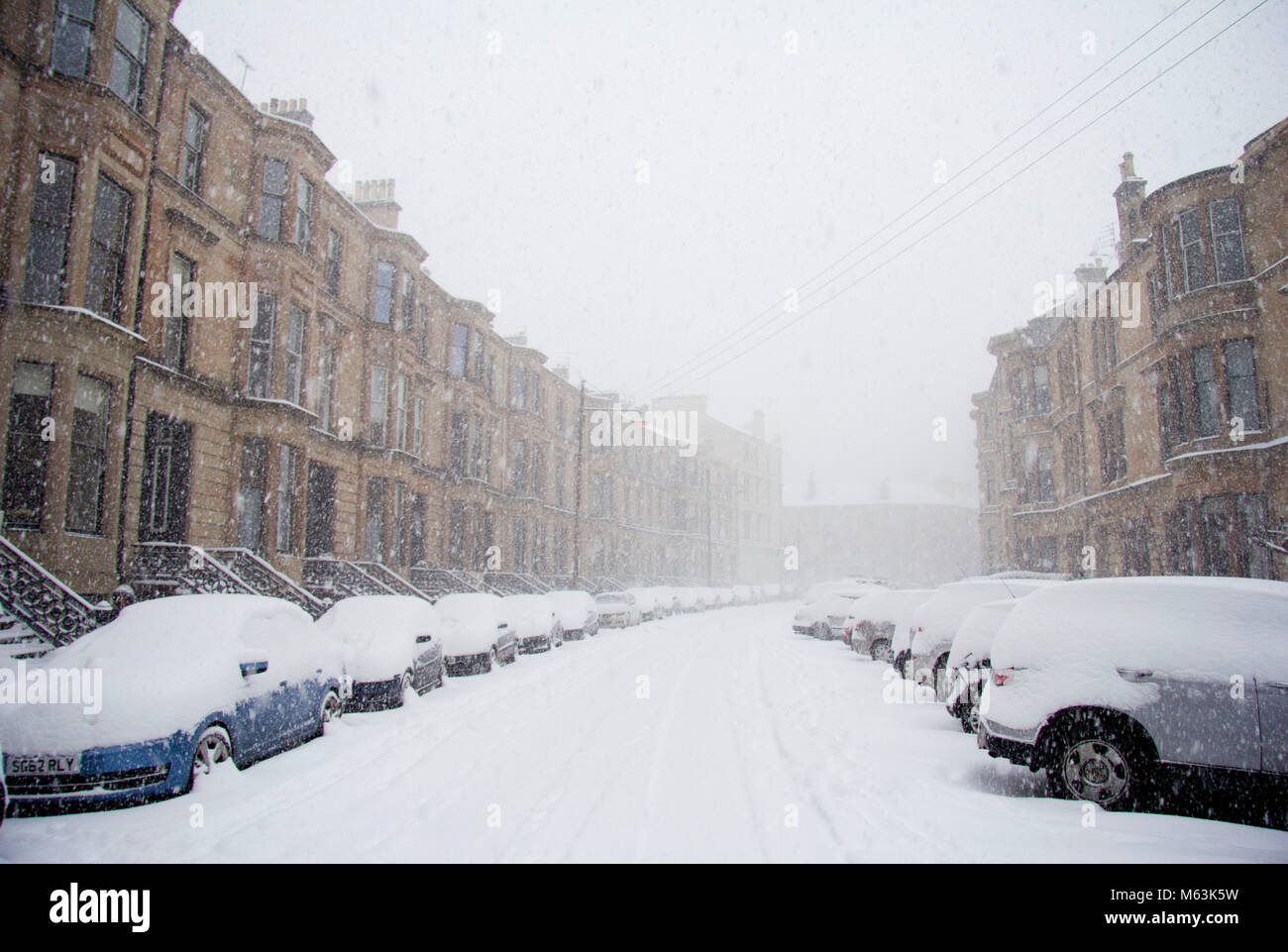 Glasgow, Scotland, UK. 28th Feb, 2018. After a lull in the earlier snow-storm, the Beast from the East resumes it's - Stock Image