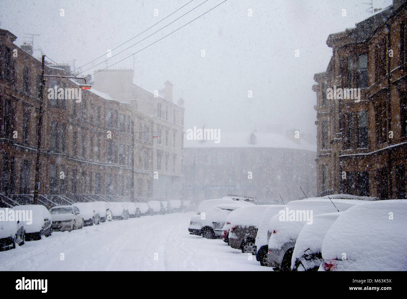 Glasgow, Scotland, UK. 28th Feb, 2018. After a lull in this morning's snow-storm, the Beast from the East resumes - Stock Image