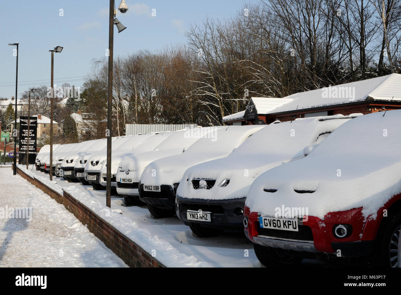 Sheffield, UK, 28th February 2018. Archer Road, Woodseats, secondhand car sales  covered in snow . Credit: Cofiant - Stock Image