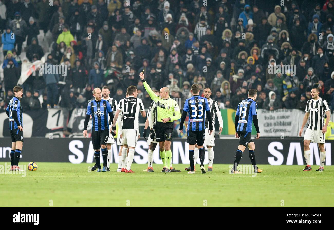 Turin, Italy. 28th Feb, 2018. Mario Mandzukic (Juventus FC),Hans Hateboer (Atalanta B.C.), Andrea Masiello (Atalanta - Stock Image
