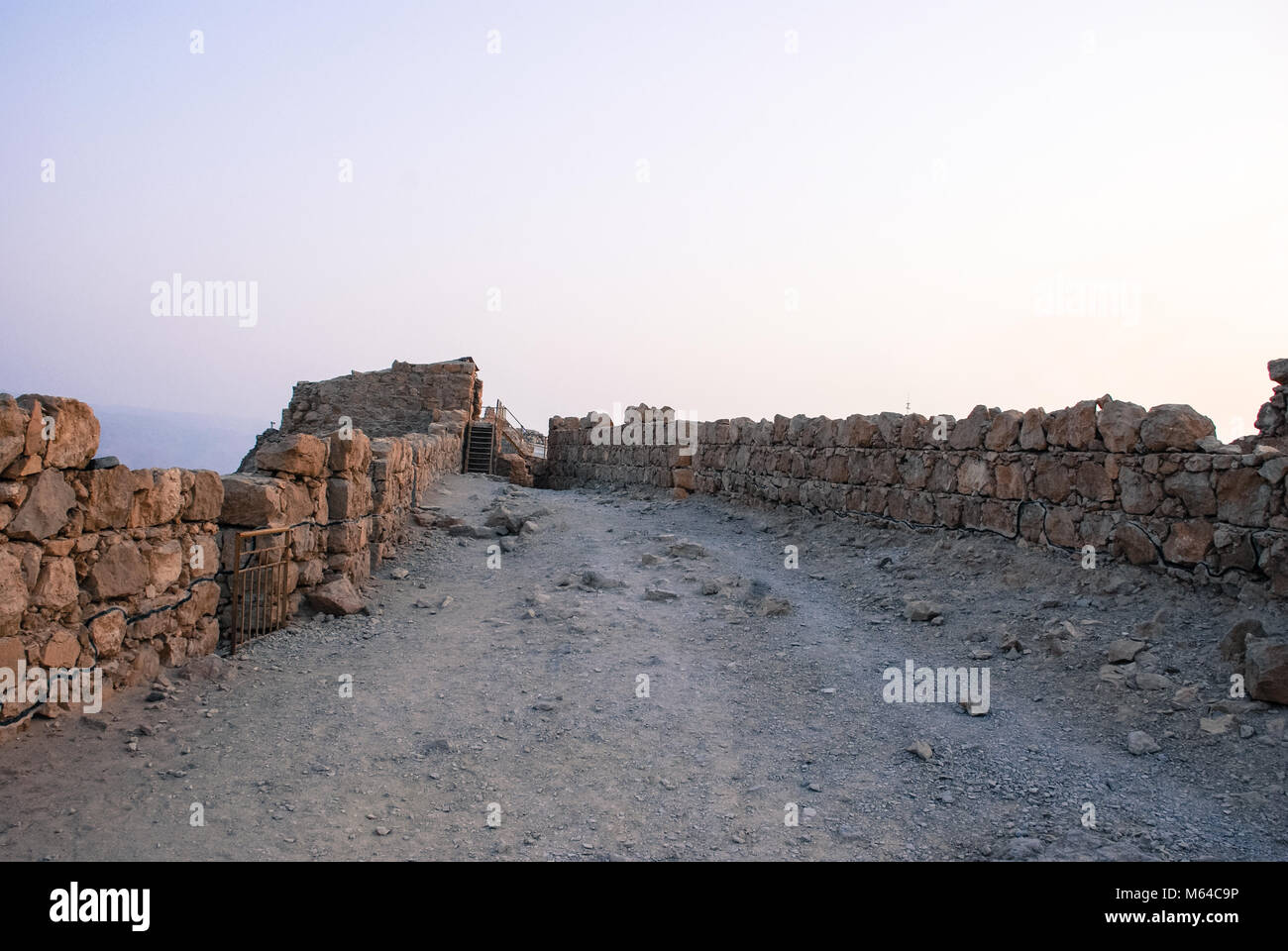 Horizonal picture of ruins of the ancient fortress of Massada on the mountain in Israel - Stock Image