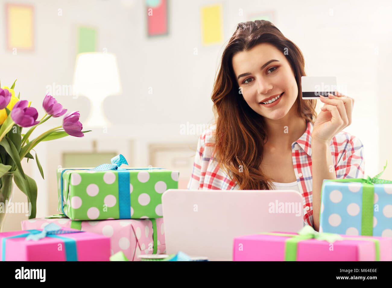 Attractive woman buying easter gifts online stock photo 175890582 attractive woman buying easter gifts online negle Images