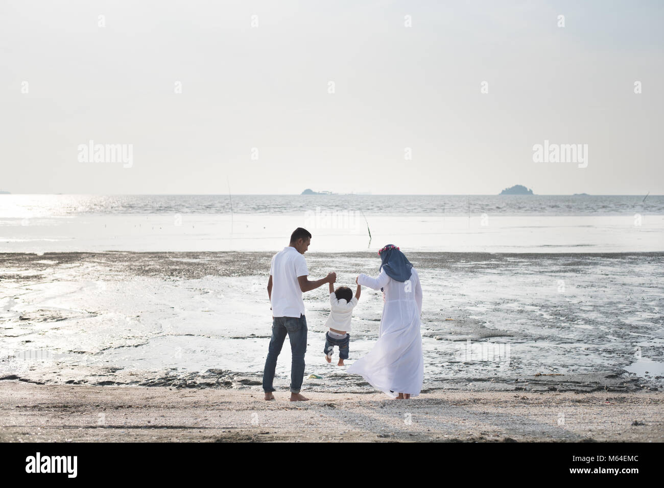 happy family having fun time together at the beach located in Pantai Remis,Kuala selangor,selangor,malaysia. family - Stock Image