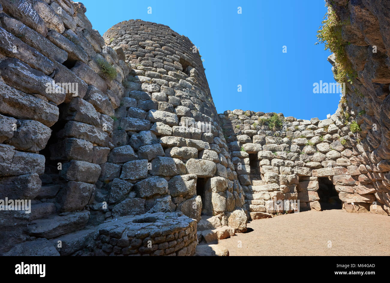 Picture and image of the central courtyard and prehistoric magalith ruins of Santu Antine Nuraghe tower, archaeological - Stock Image
