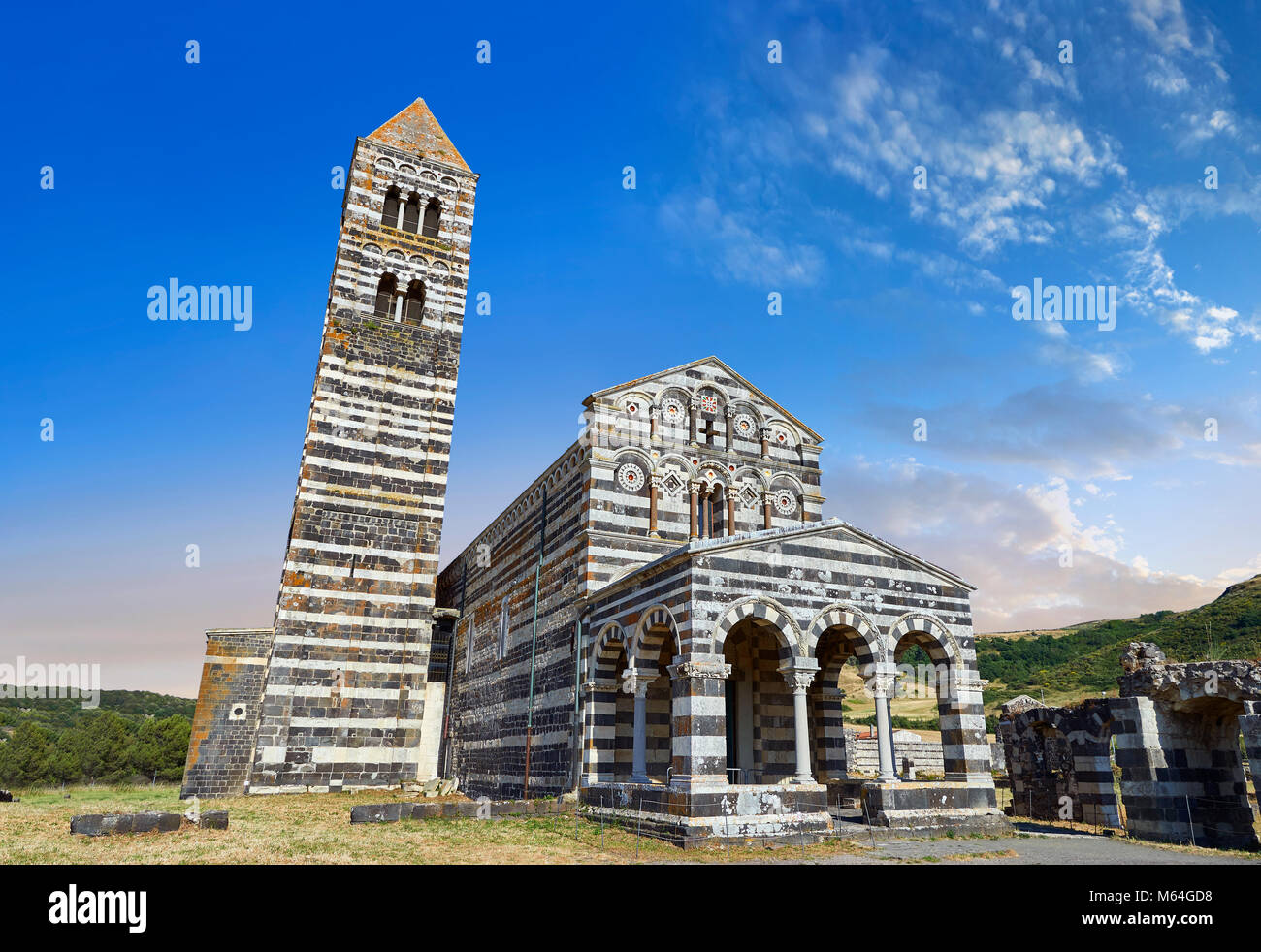 Picture and image of the exterior of the Tuscan Romanesque Pisan style basilica of Santissima Trinita di Saccargia, Stock Photo