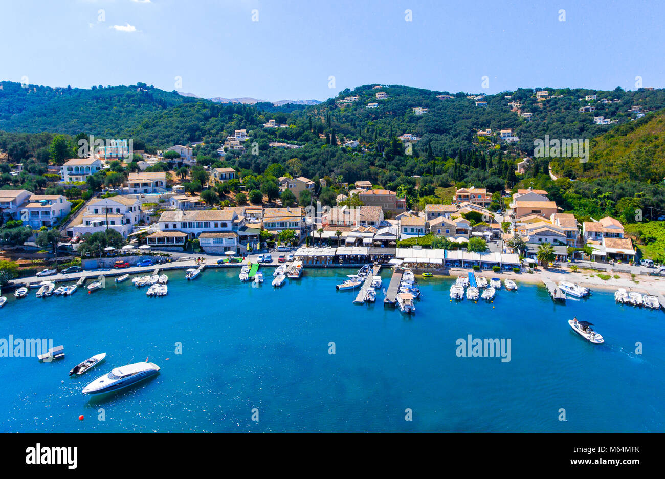Agios Stefanos bay, one of the most beautiful fishing villages in Corfu Island. Kerkyra, Greece. - Stock Image