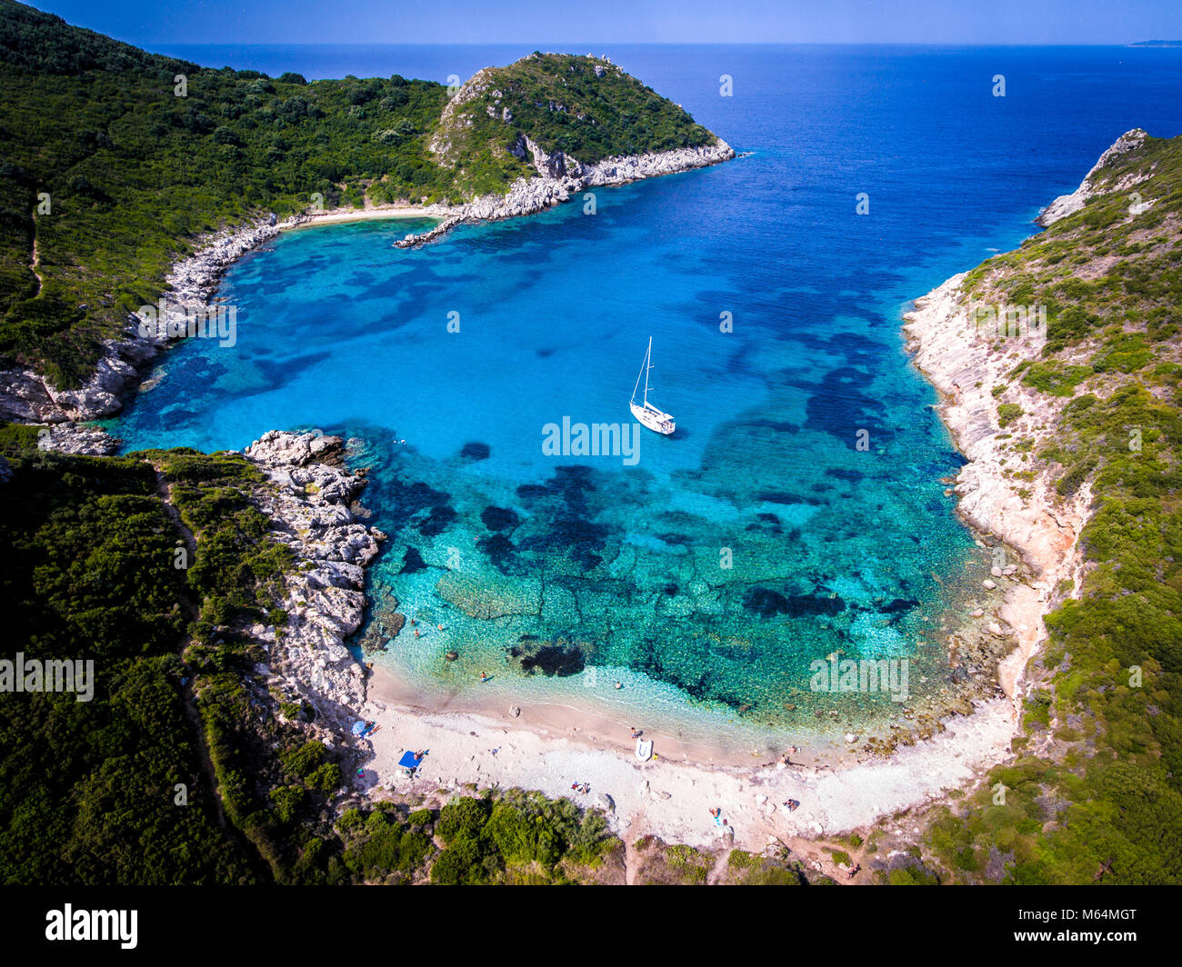 Porto Timoni, on of the hidden beaches of Corfu Island, also known as Kerkyra, near Agios Giorgios beach. Turqoise Stock Photo