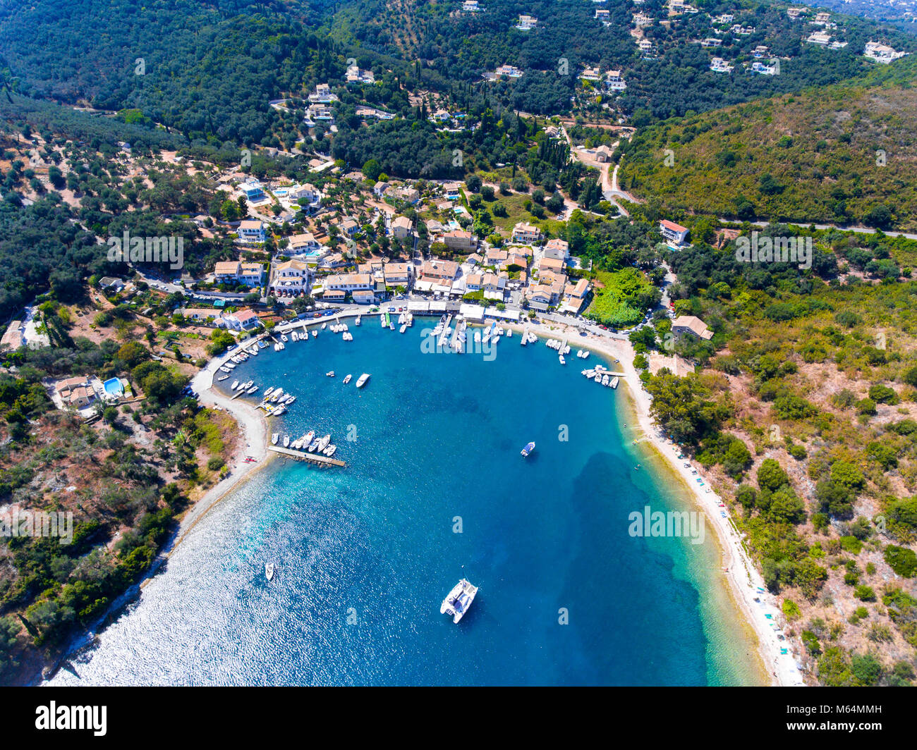 Agios Stefanos bay, one of the most beautiful fishing villages in Corfu Island. Kerkyra, Greece. Aerial view. - Stock Image