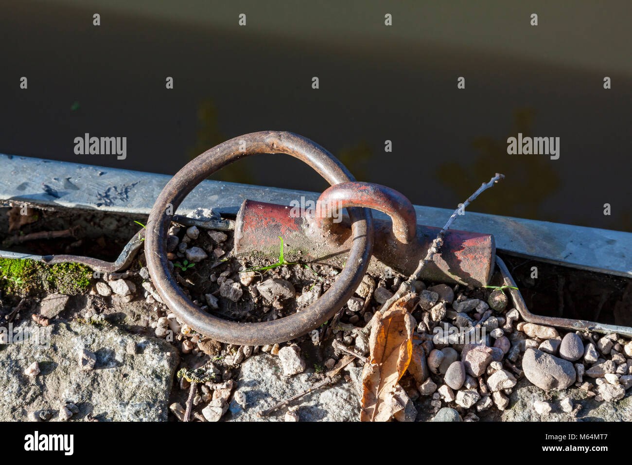 Rusty mooring ring at Tatenhill Lock on the Trent and Mersey canal, Branston, Staffordshire, UK - Stock Image