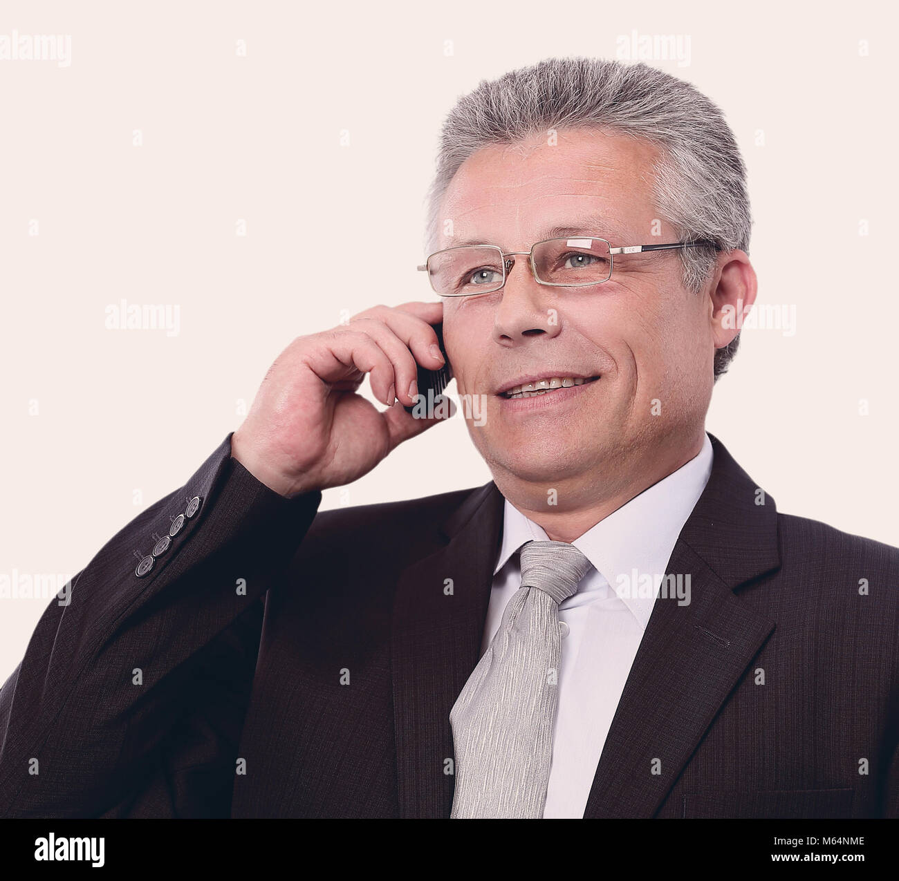 bbc52ff870 Portrait of a mature gray-haired business man calling. - Stock Image