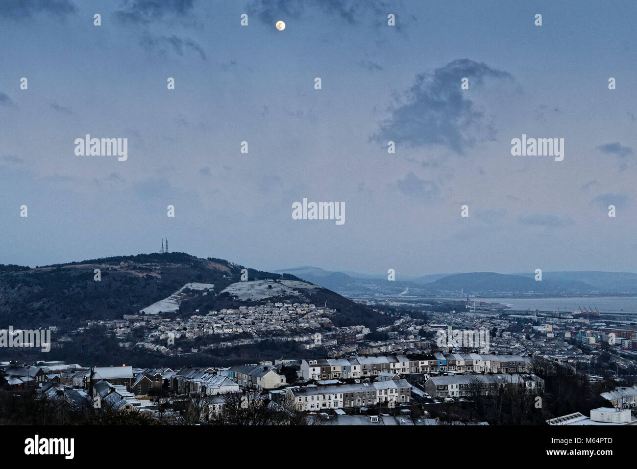 Pictured: The lunar phonomenon known as Black Moon is seen over the St Thomas area of Swansea where snow caused - Stock Image