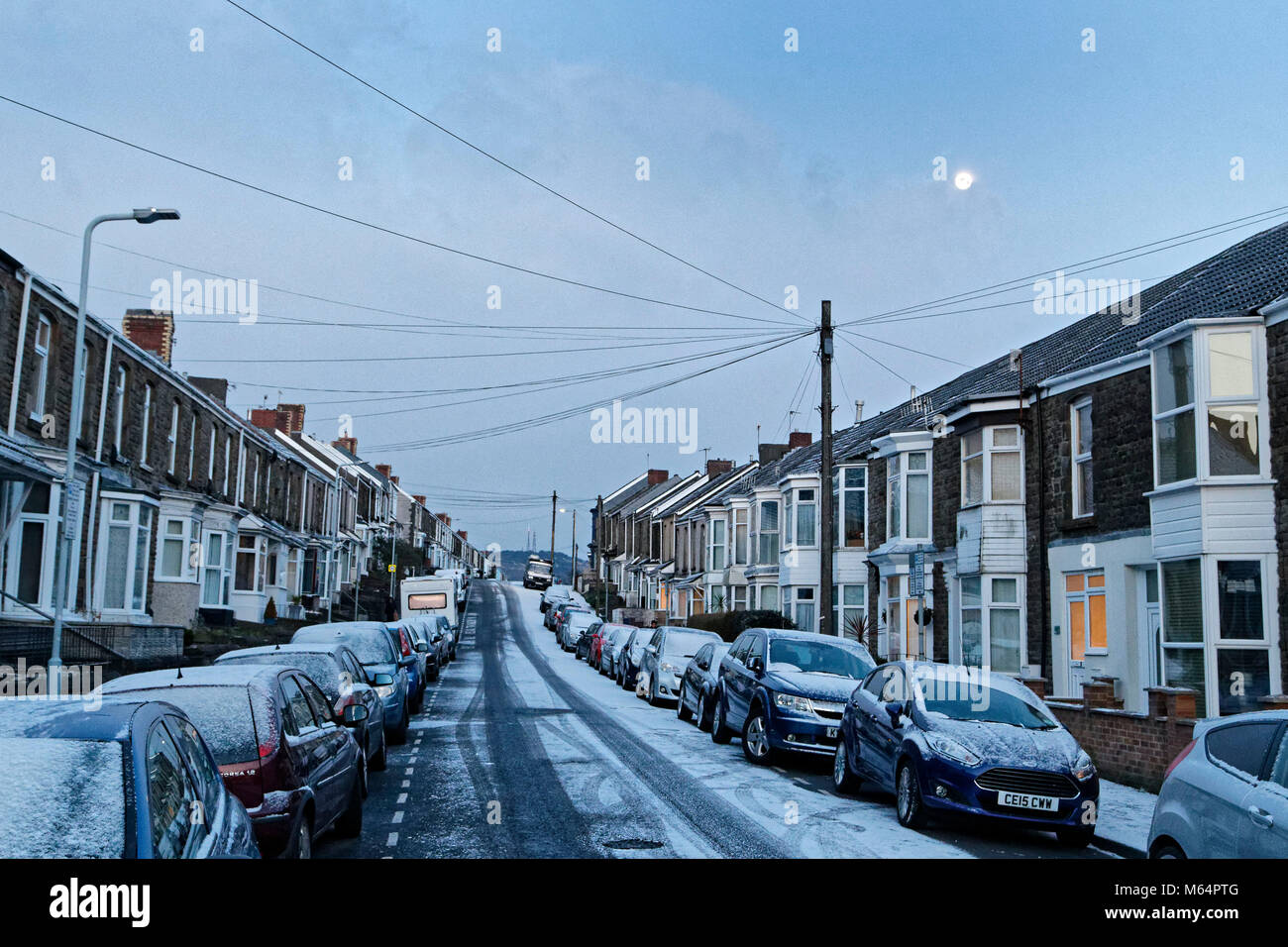 Pictured: The lunar phonomenon known as Black Moon is seen over snow covered houses in Rhondda Street in the Mount - Stock Image